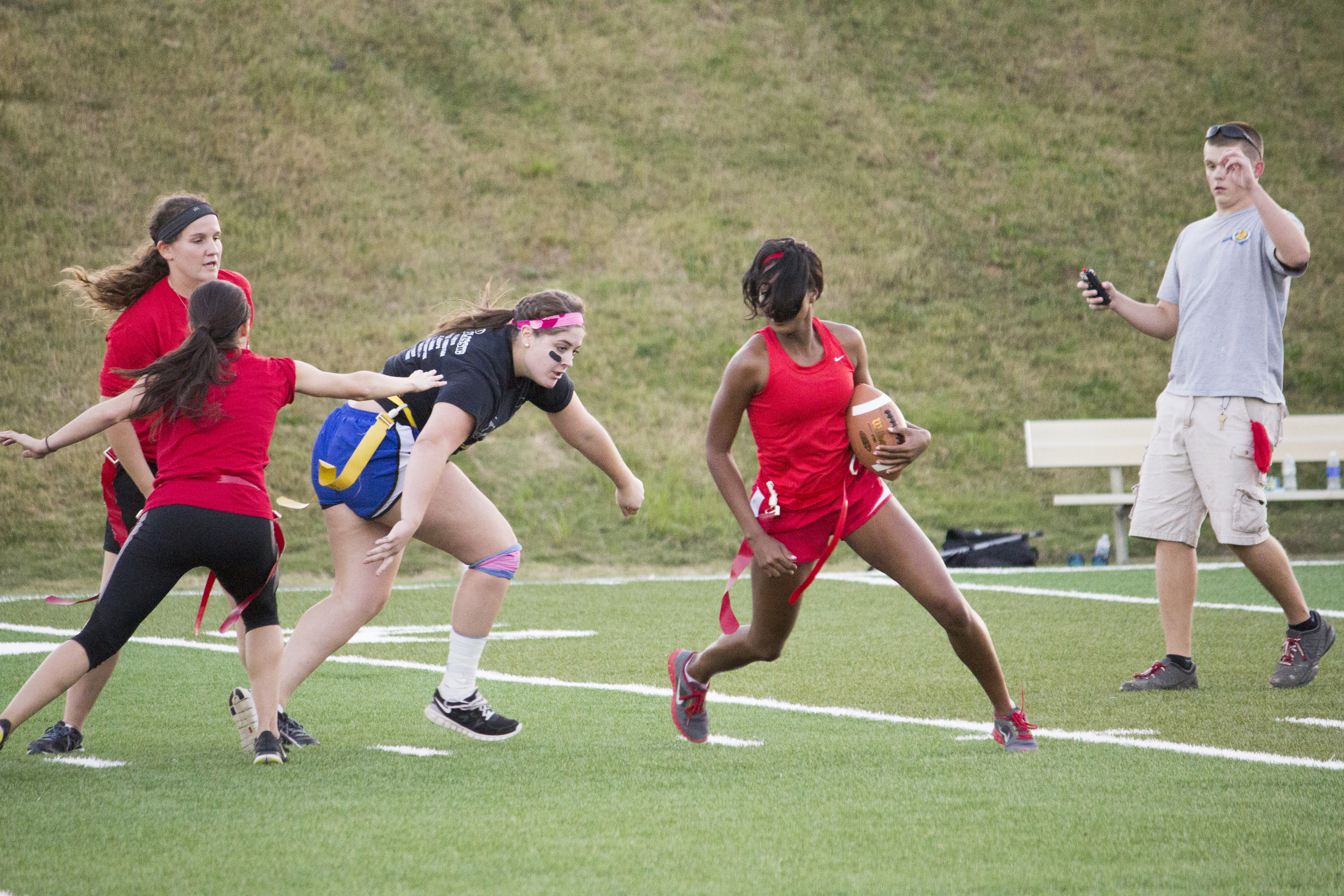 Senior Jackia Whetstone makes a running play to her left to avoid the oncoming junior player Kayla Samoros.