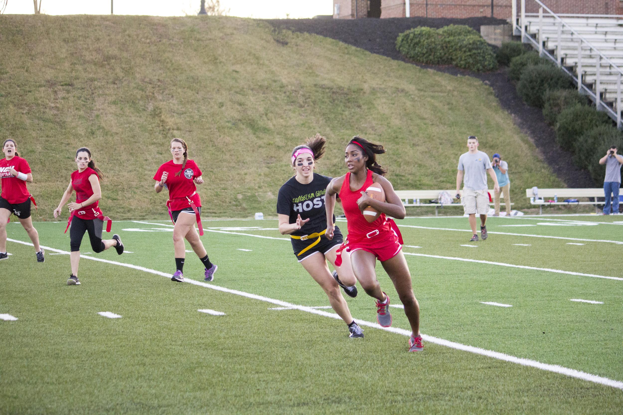 Junior Libby Sherer races downfield towards senior Jakia Whetstone to end the play.