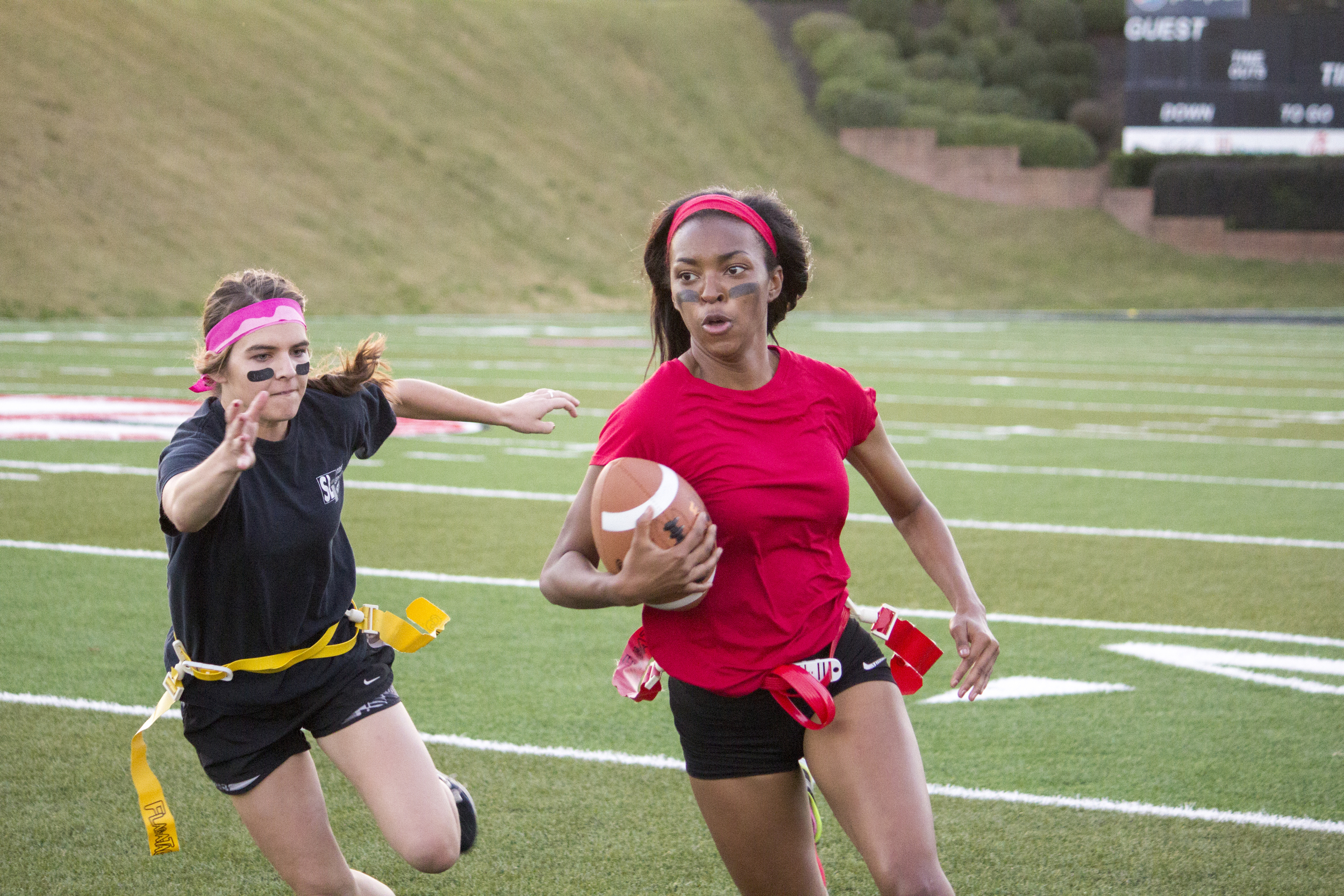 Senior Jackia Whetstone tries to avoid a rival junior player from snagging her flag.