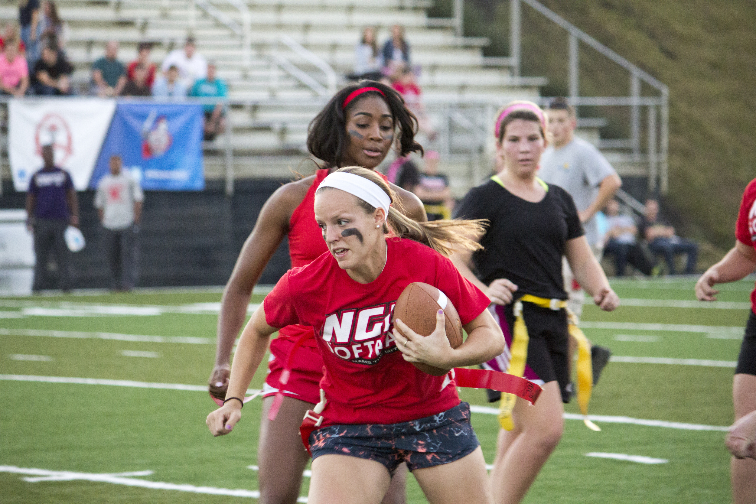 Senior Sarah Armstrong runs with determination down the left side of the field.