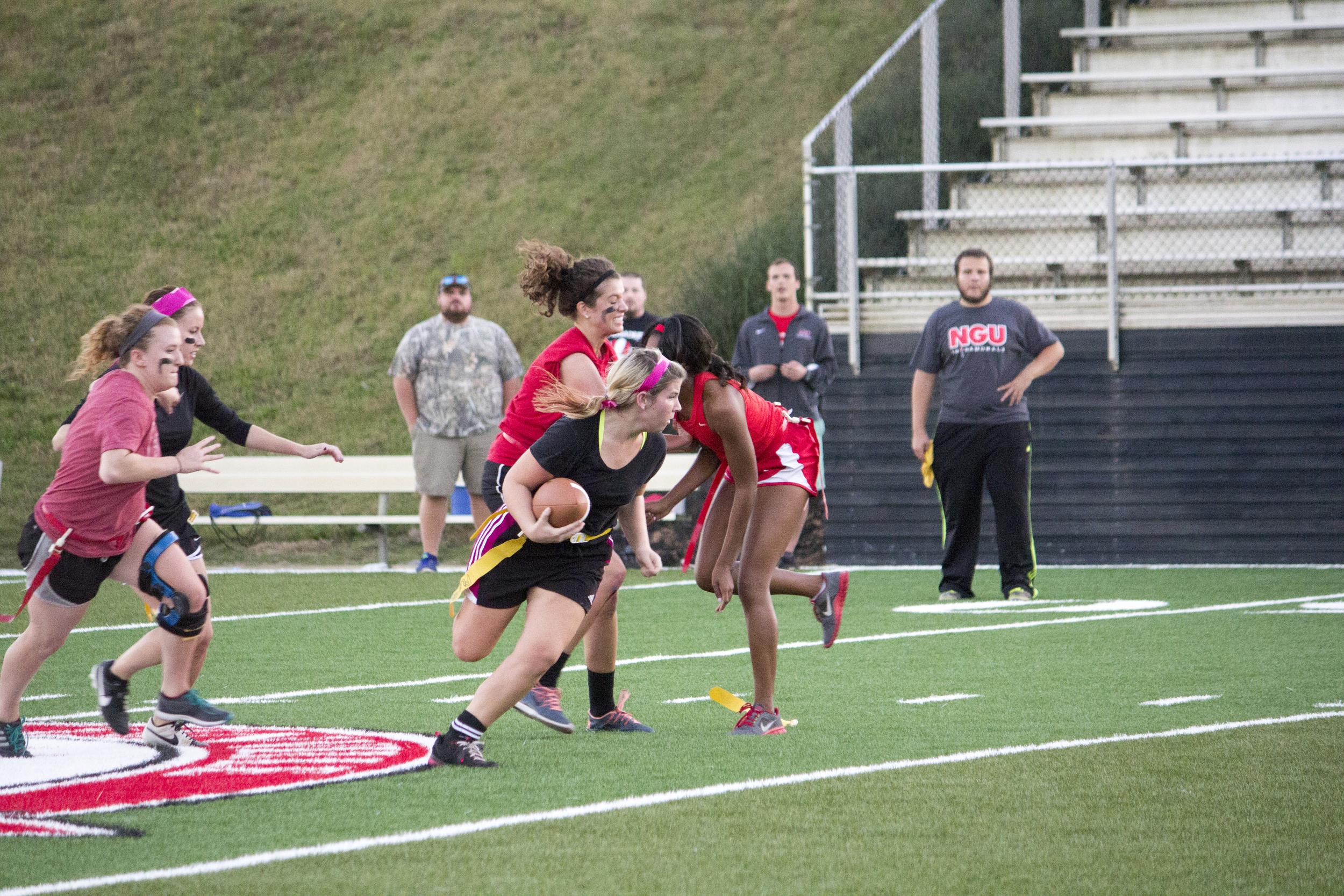 Junior Alexandria Cloer tries to sneak past her rival senior players.
