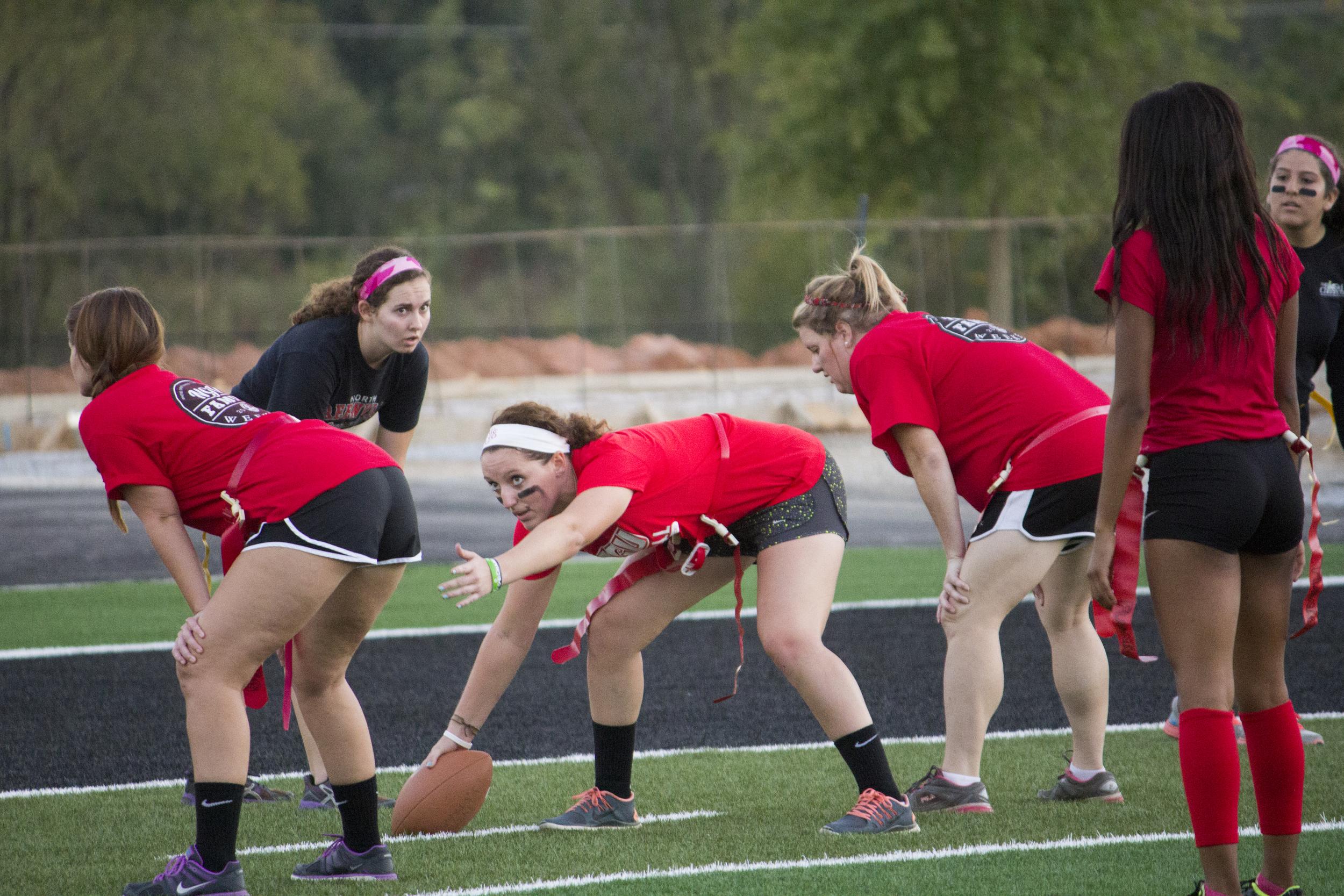 Senior Tori Freedman directs her fellow teammates before she hikes the ball.