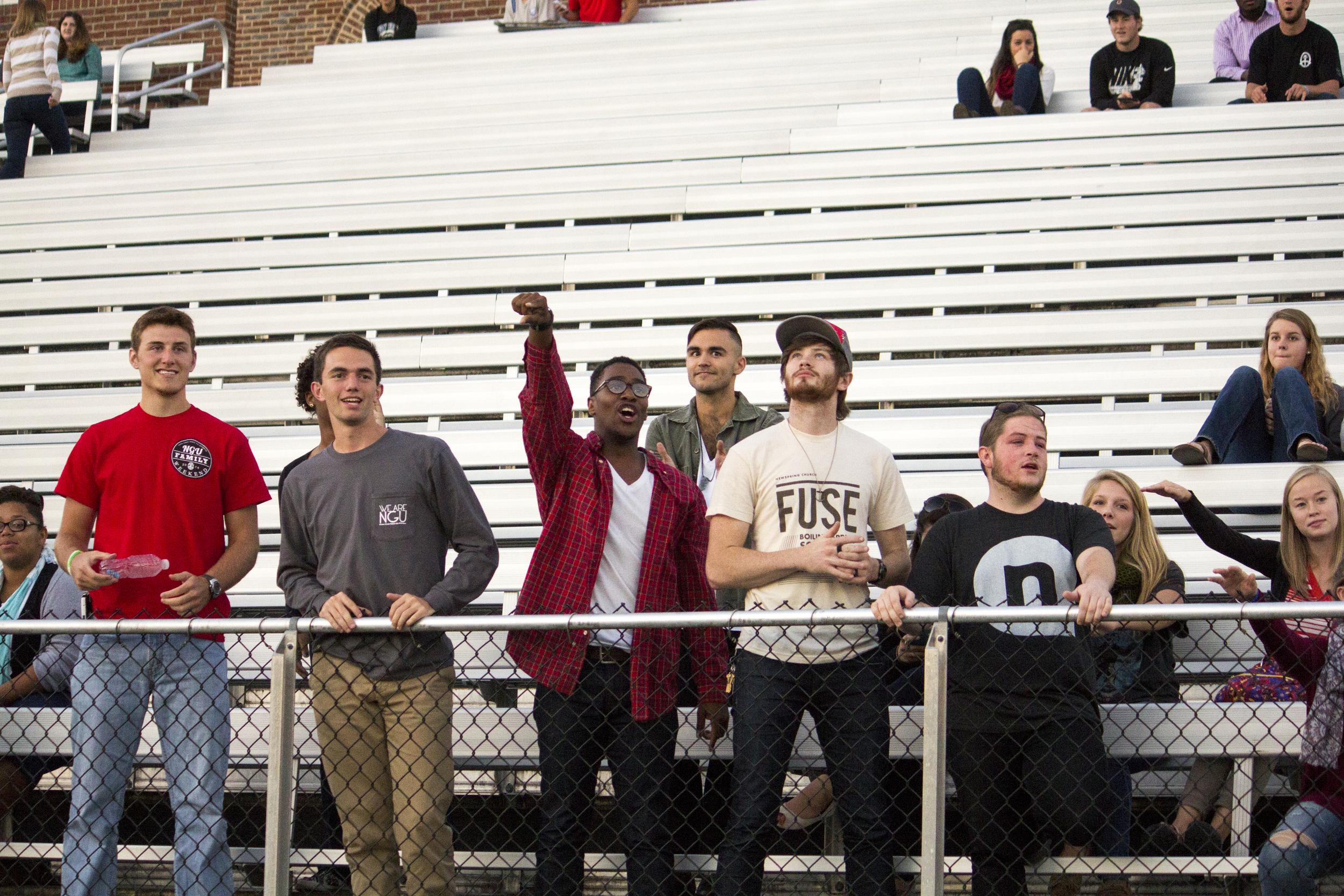 Some senior guys cheer on their fellow senior ladies during the powderpuff football game.