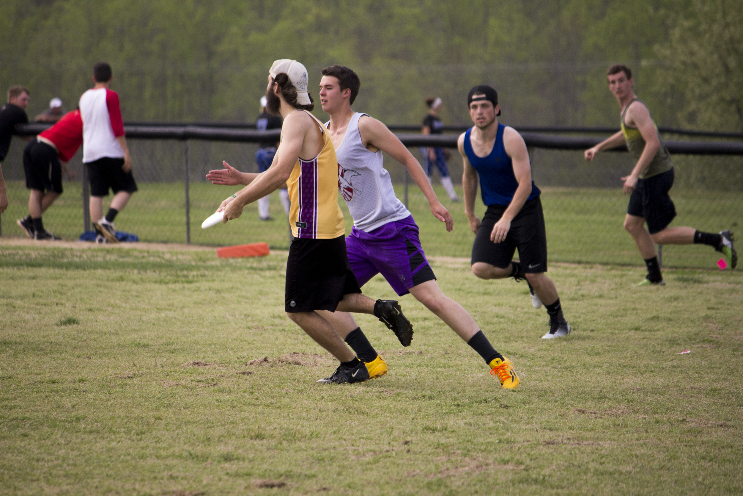 Senior Eric Payne looks downfield to pass to one of his members.