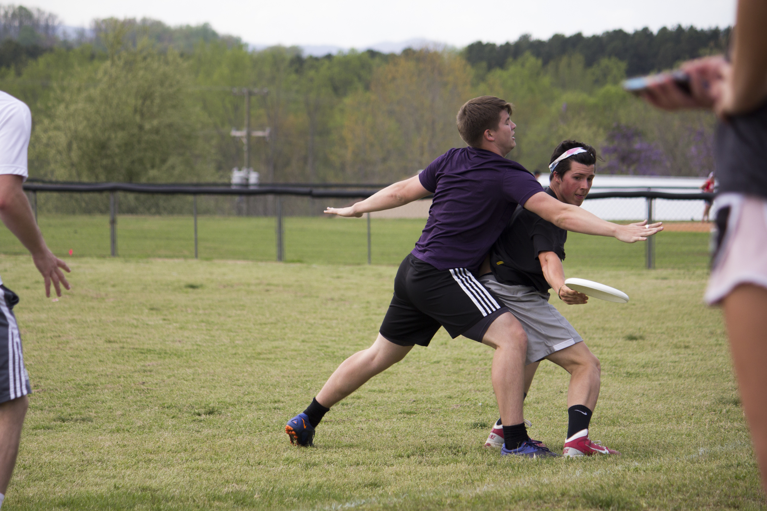 Sophomore Charlie Mitchell tries to block a throw from being completed.