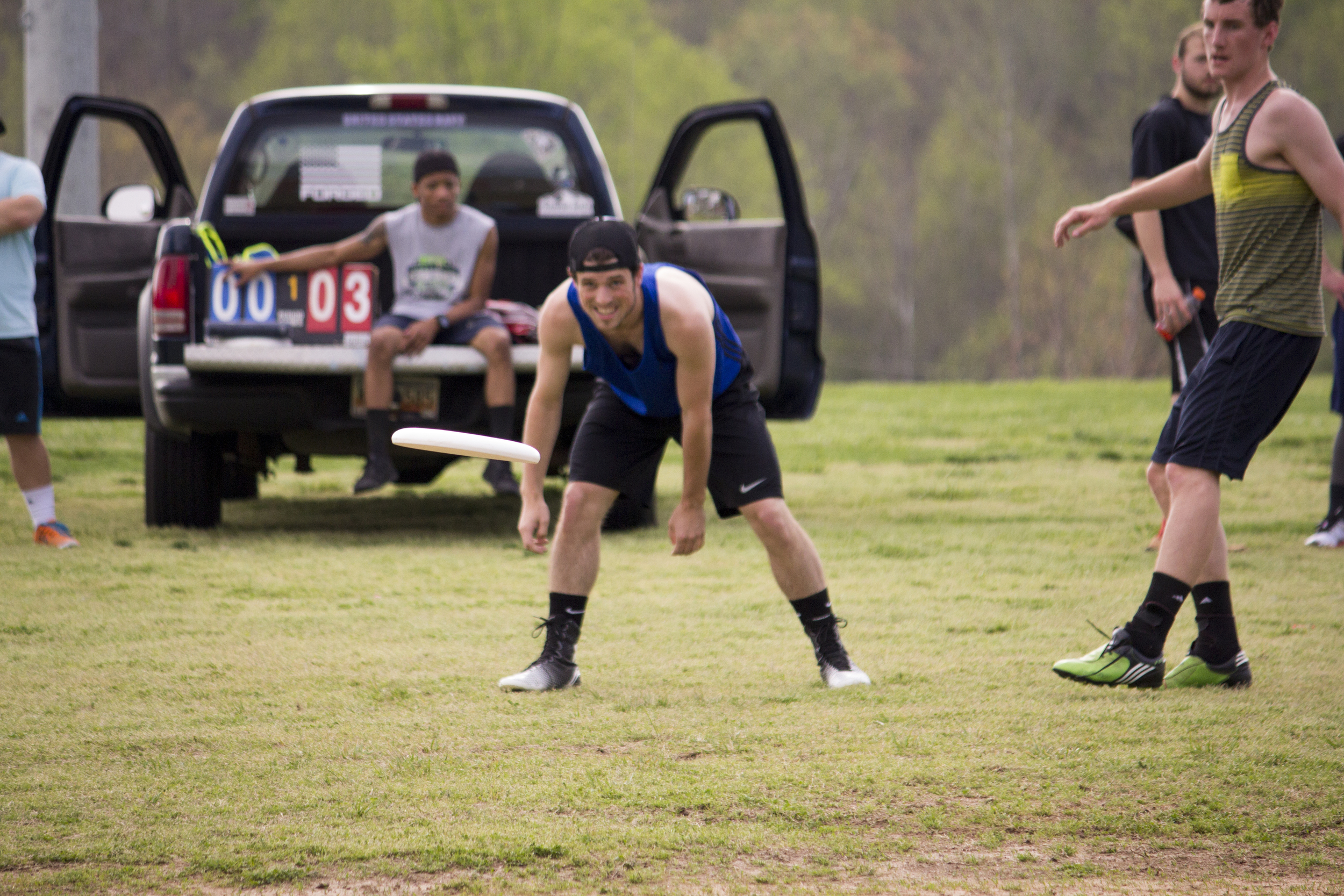 Daniel Shamblin watches his released frisbee as his teammate runs to catch it.