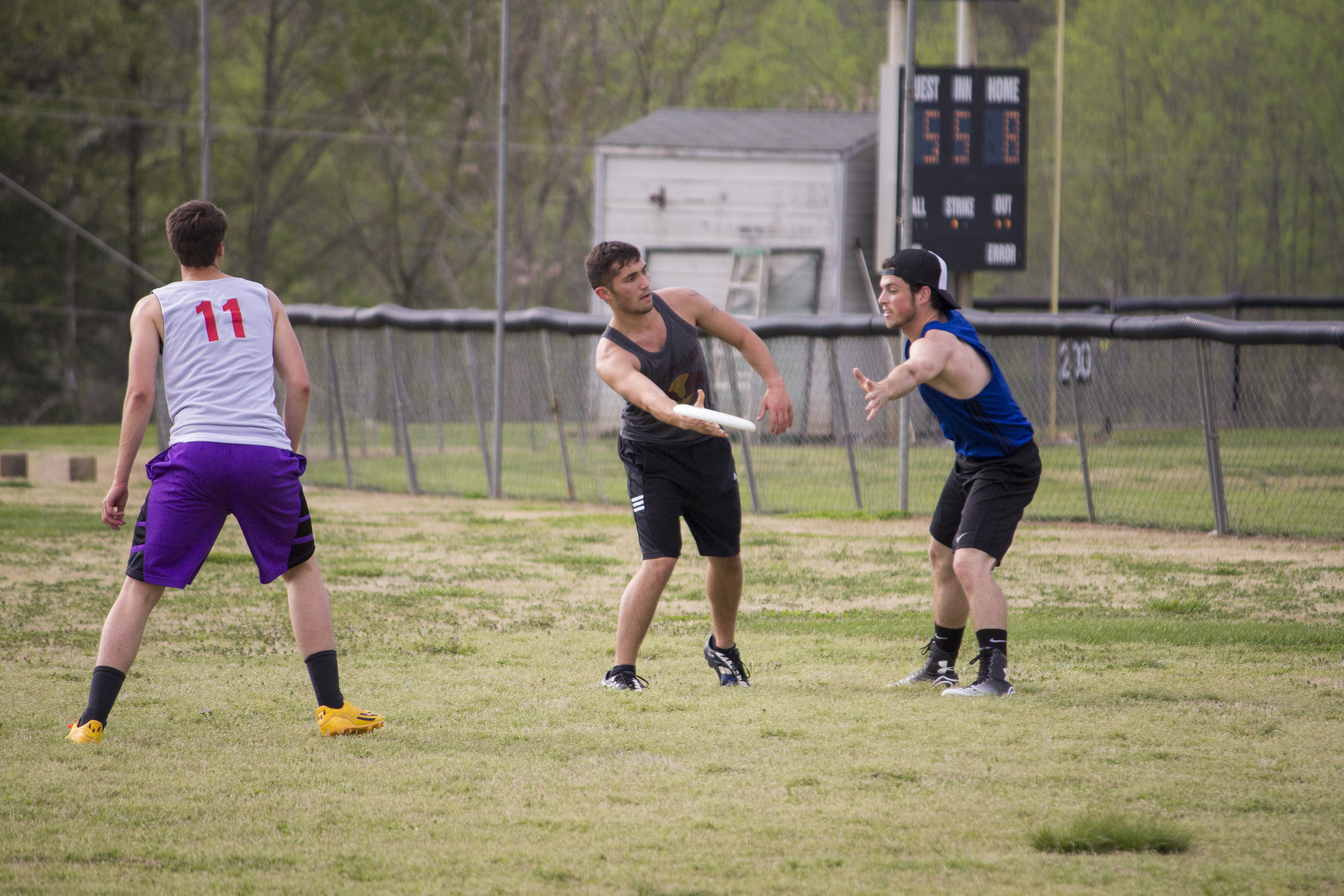 Josh Mckeown flicks the frisbee to the right side to score a point.