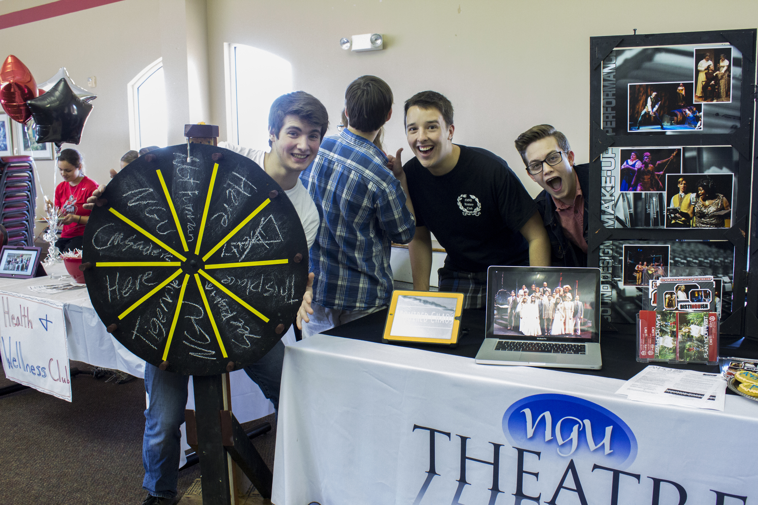 The NGU theatre crew show their well knownenthusiasm for those who pass by.