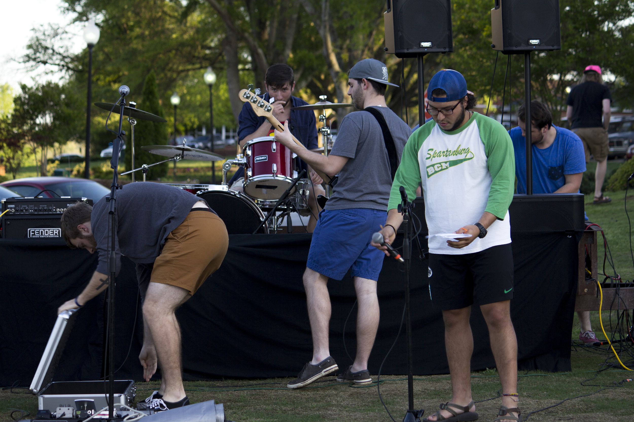 Members of different bands test out their gear while the sound guys run last minute tests.