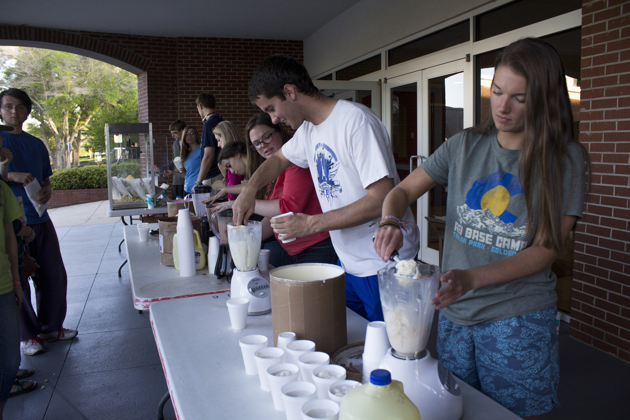Student Activites serves milkshakes at the Battle of the Bands.