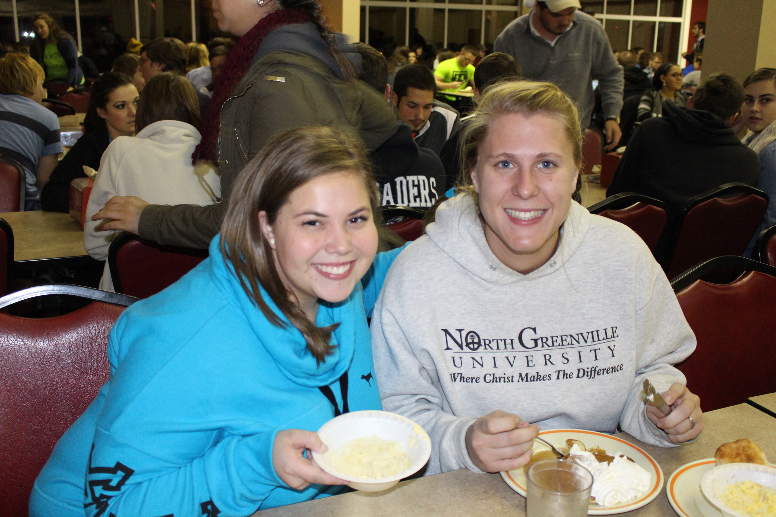 Abby Batson and Ashley Silvey enjoy the grits and pancakes before exams begin.
