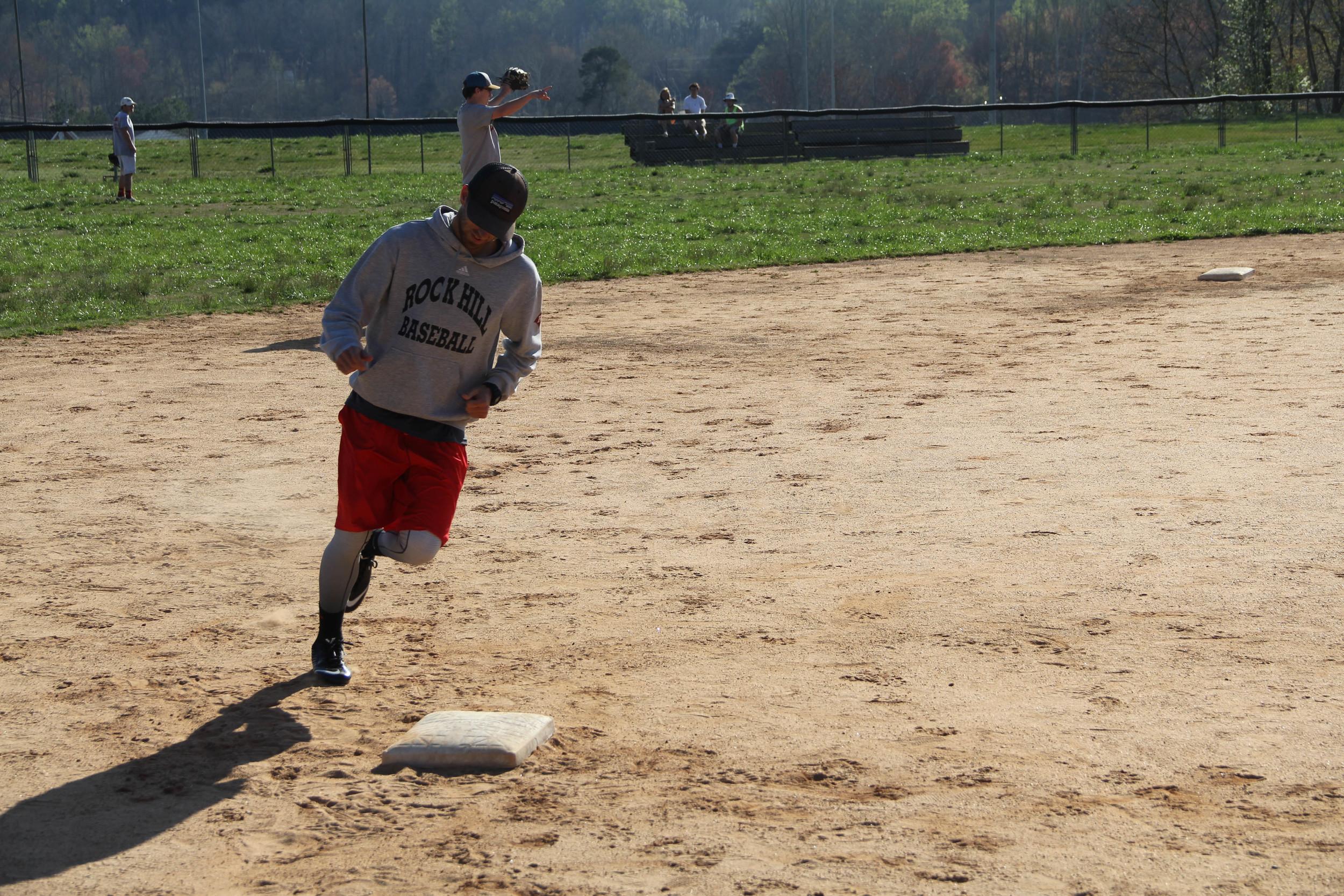 Stewart Hunt jogs around third base.
