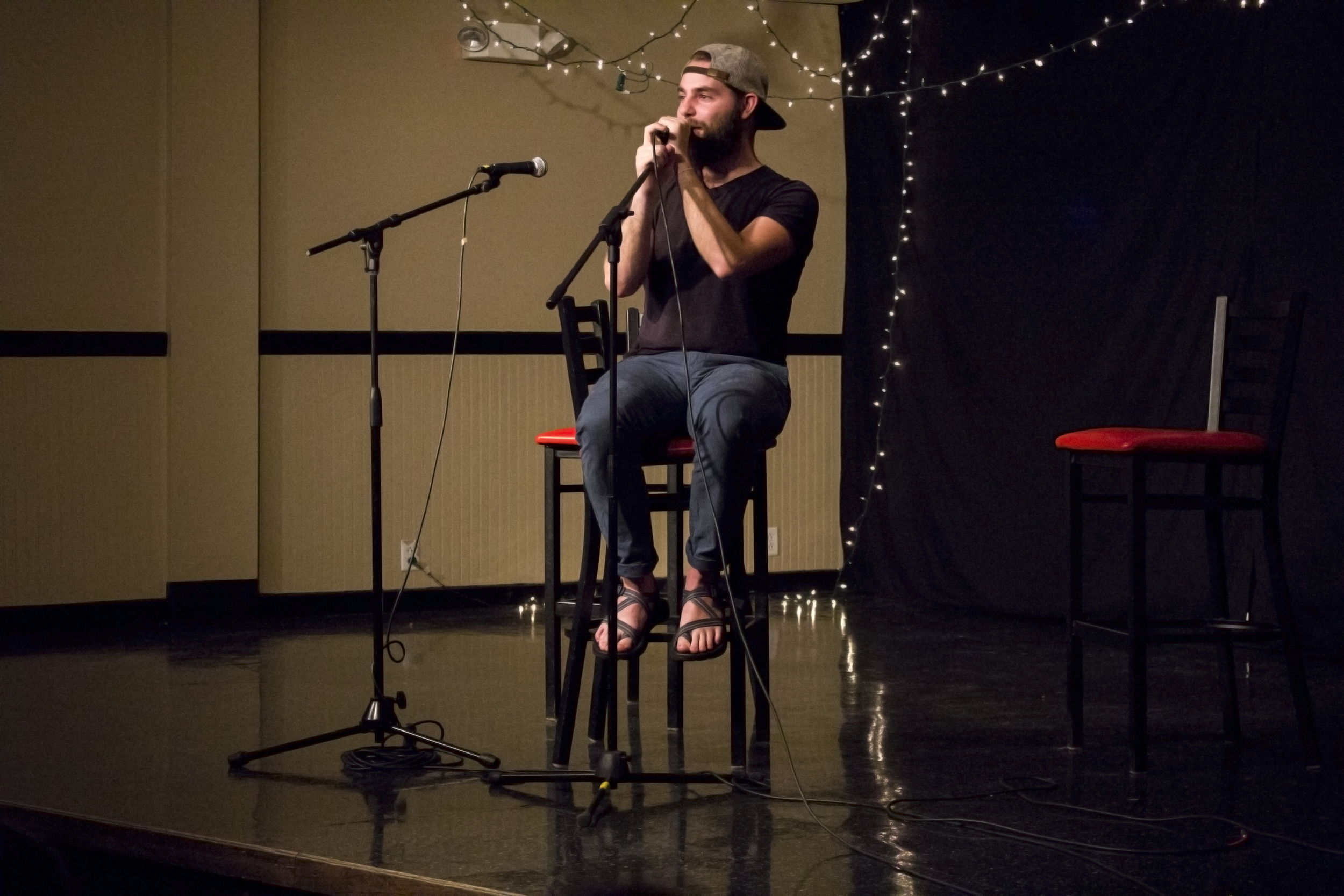"""Drew Norris acts as the MC of the night by singing """"Oh Where Is My Hairbrush"""" to fill the time before getting the winner results for the night."""