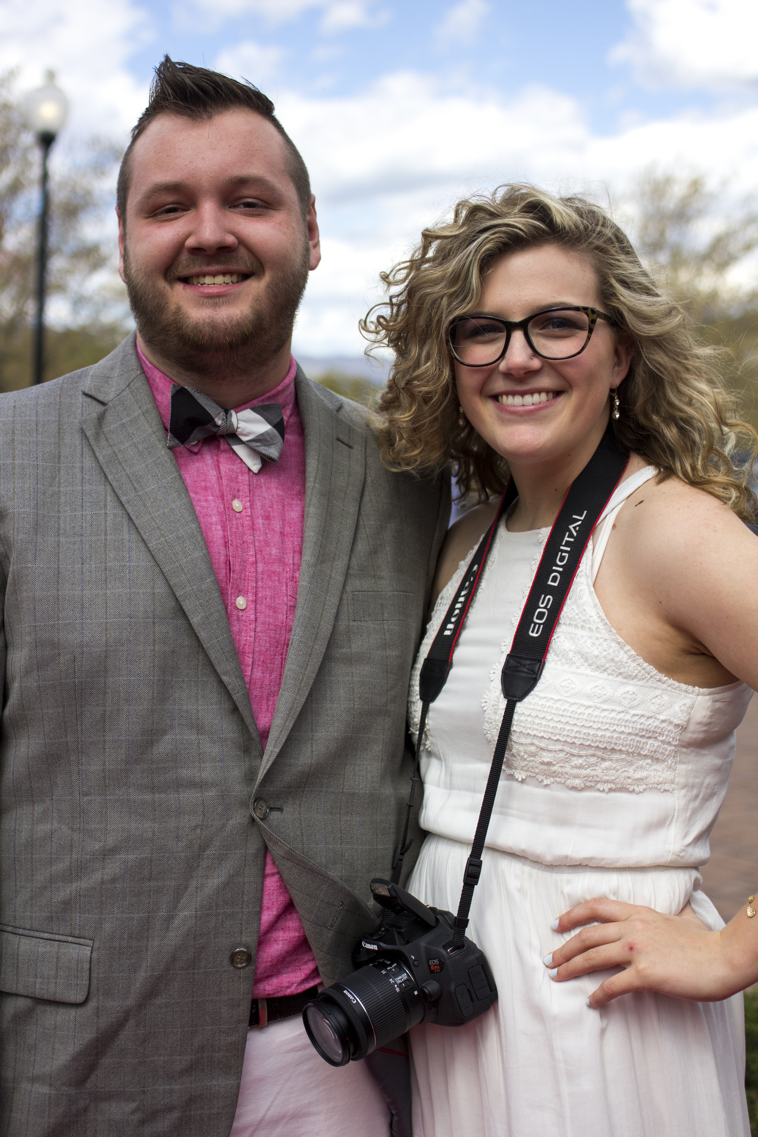Carli Frady takes a break from taking pictures to have her own red carpet moment with Adam Polk.