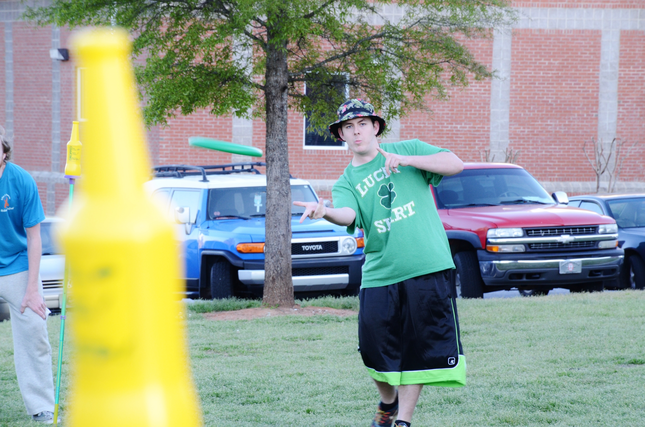 Brian Cordle shows his frisbee skills as he tries to knock down a bottle in a game of Polish.