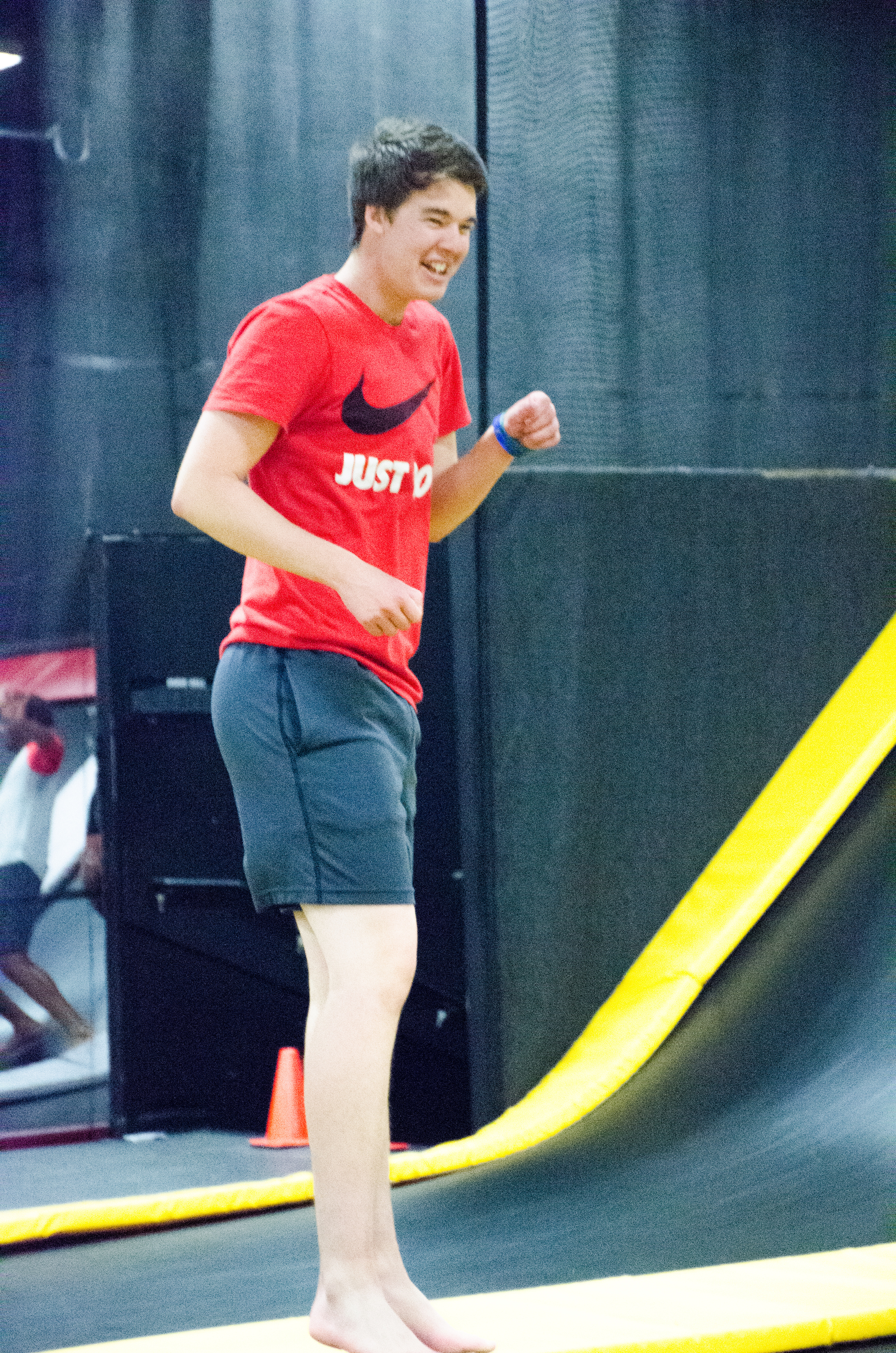 Josh Leister laughs with his friends while jumping on the trampolines.