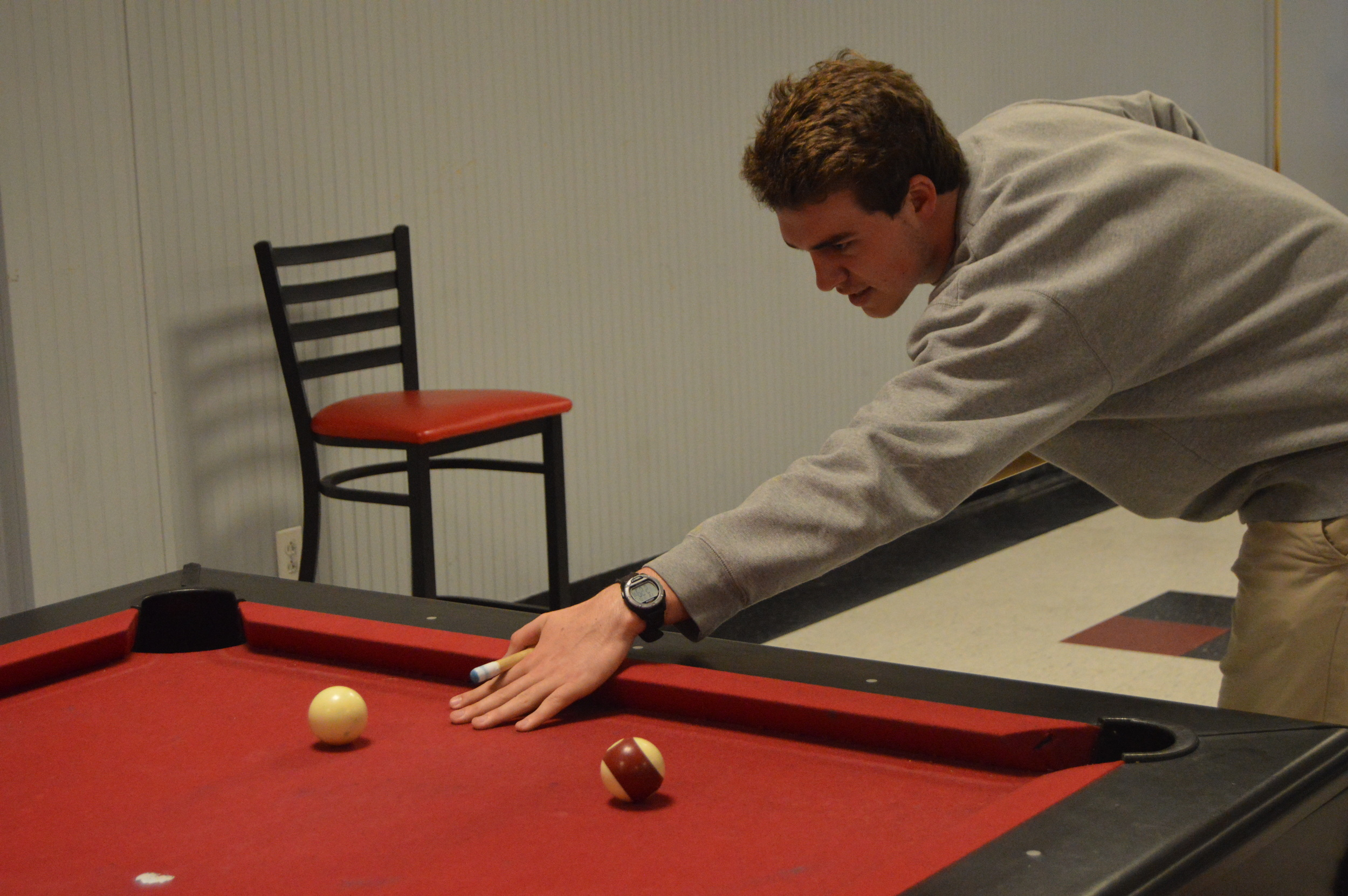 Jesse Erwin lines up to hit the cue ball.
