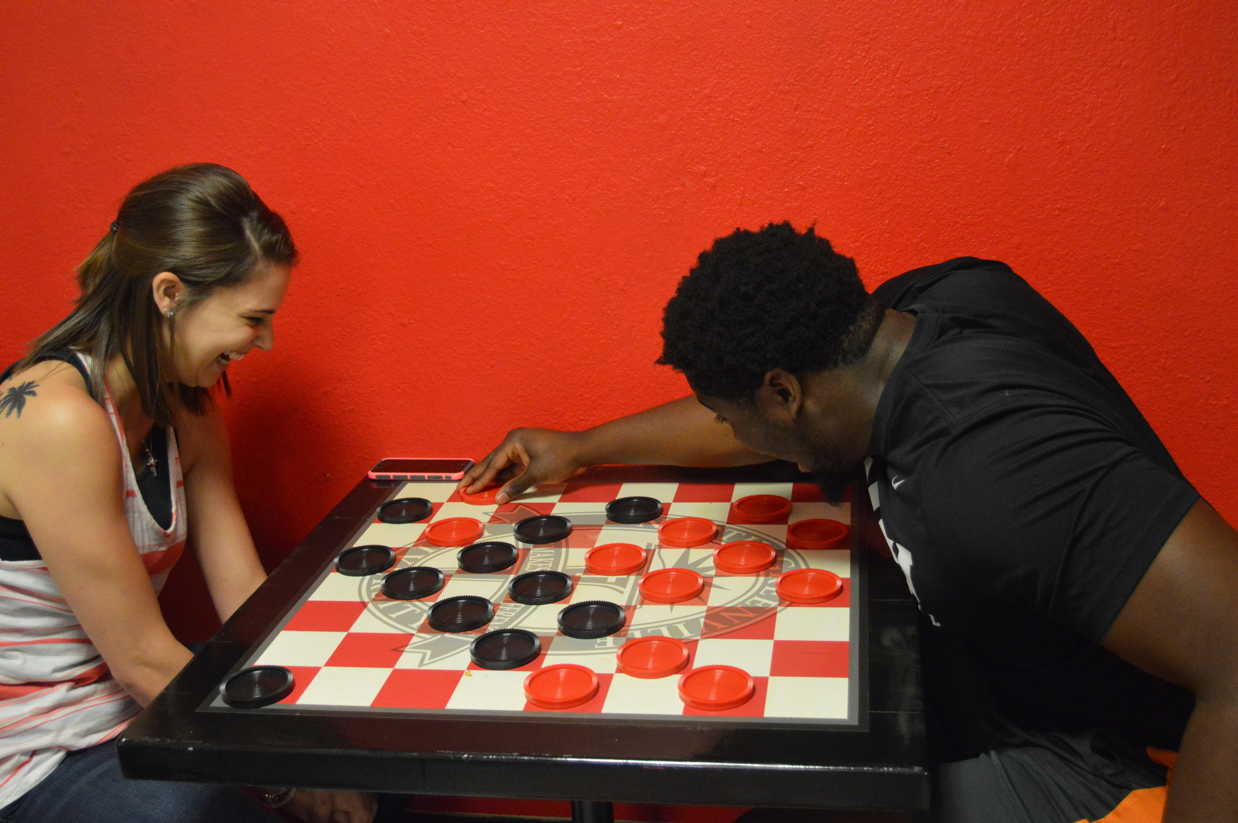 Tiffany Egan and Dominique Richardson engage in a lively chess match.