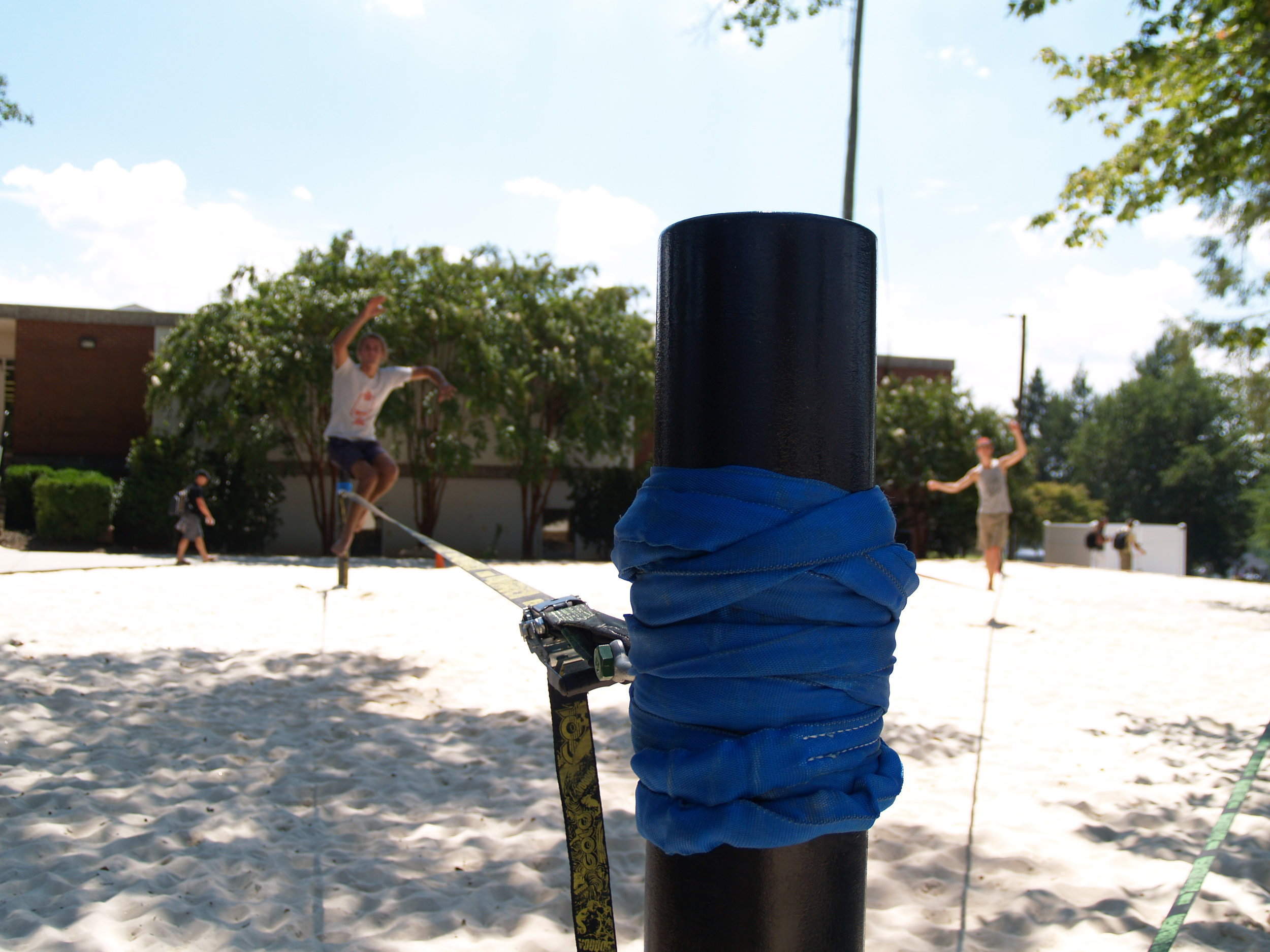 Students set up and test out the new slack lining equipment.