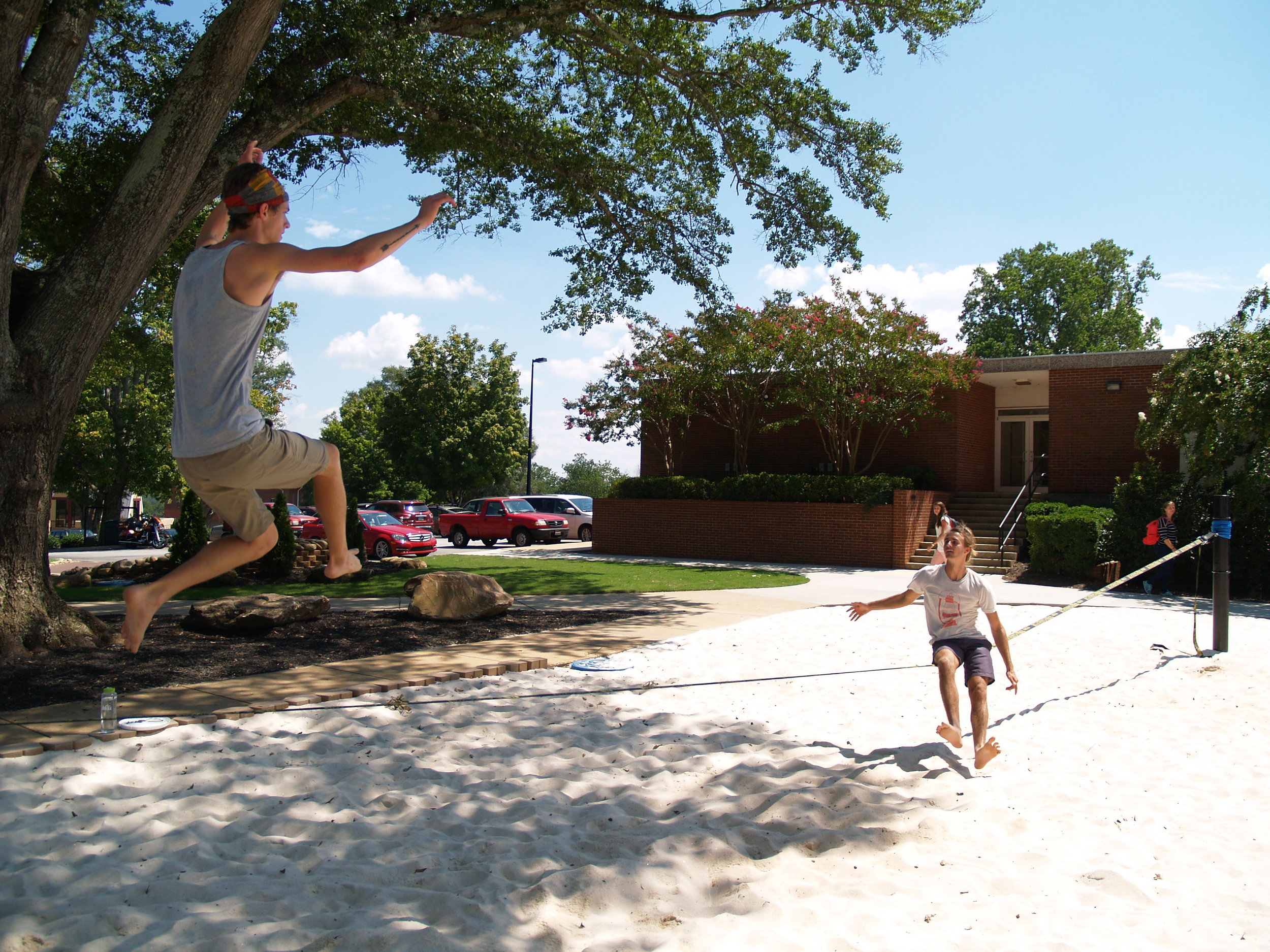 Conner Mcabee and Mac Daniel pull off a slack lining stunt in front of students.
