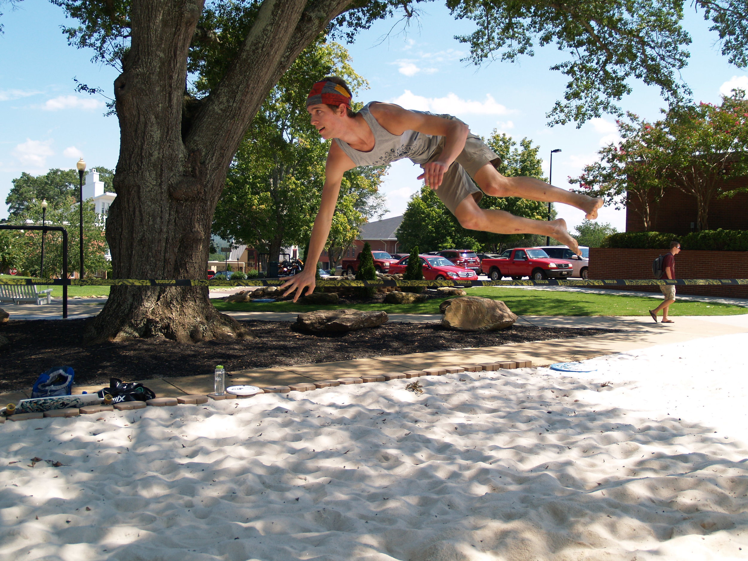 NGU senior Conner Mcabee tries out a few different slack lining tricks.