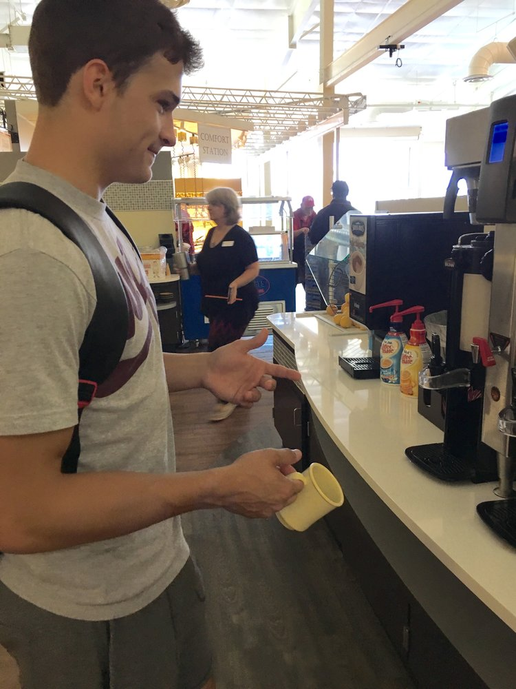 A student gets a beverage at the coffee station in the newly-renovated dining hall.