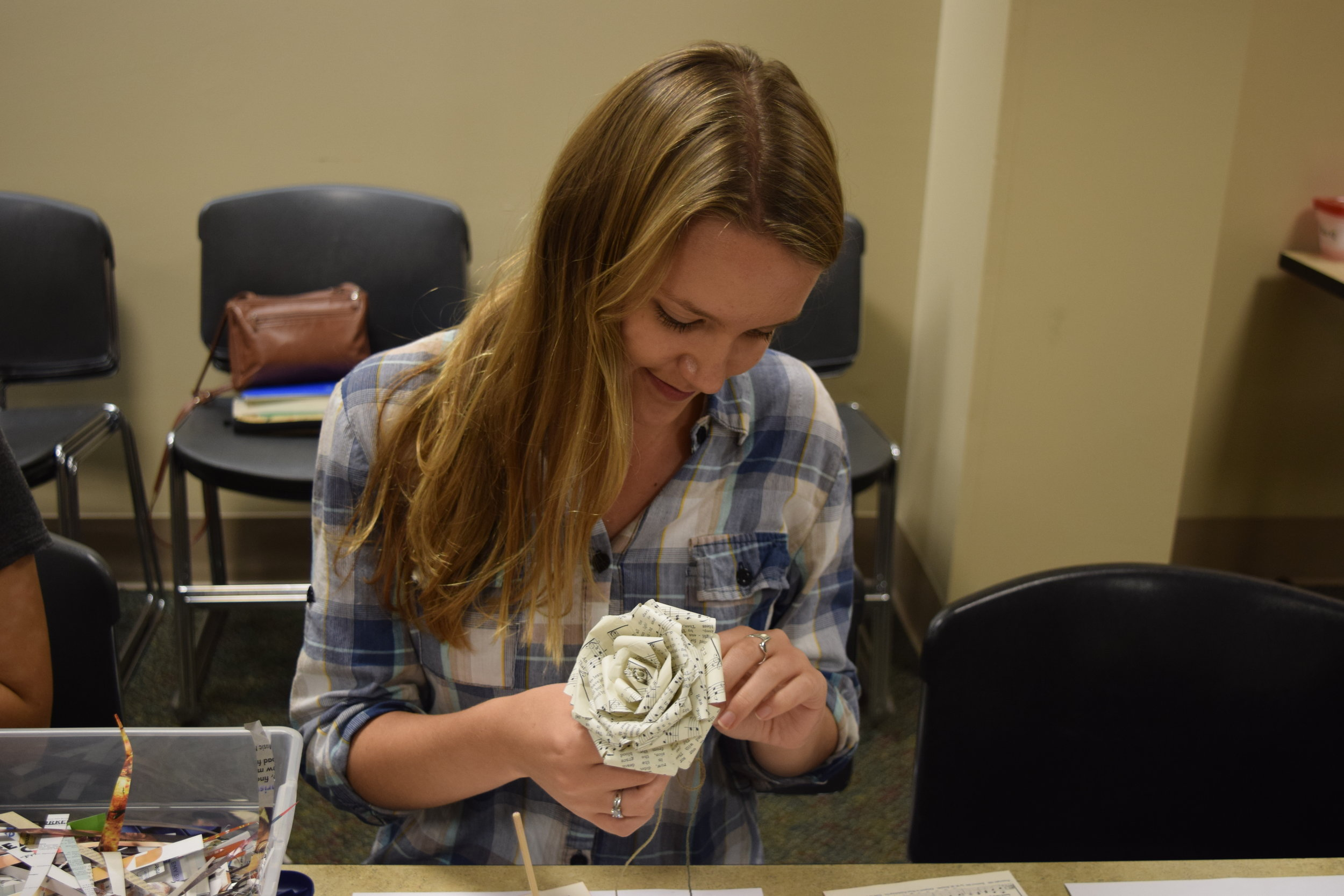 Bridget Pierce crafts her paper rose.