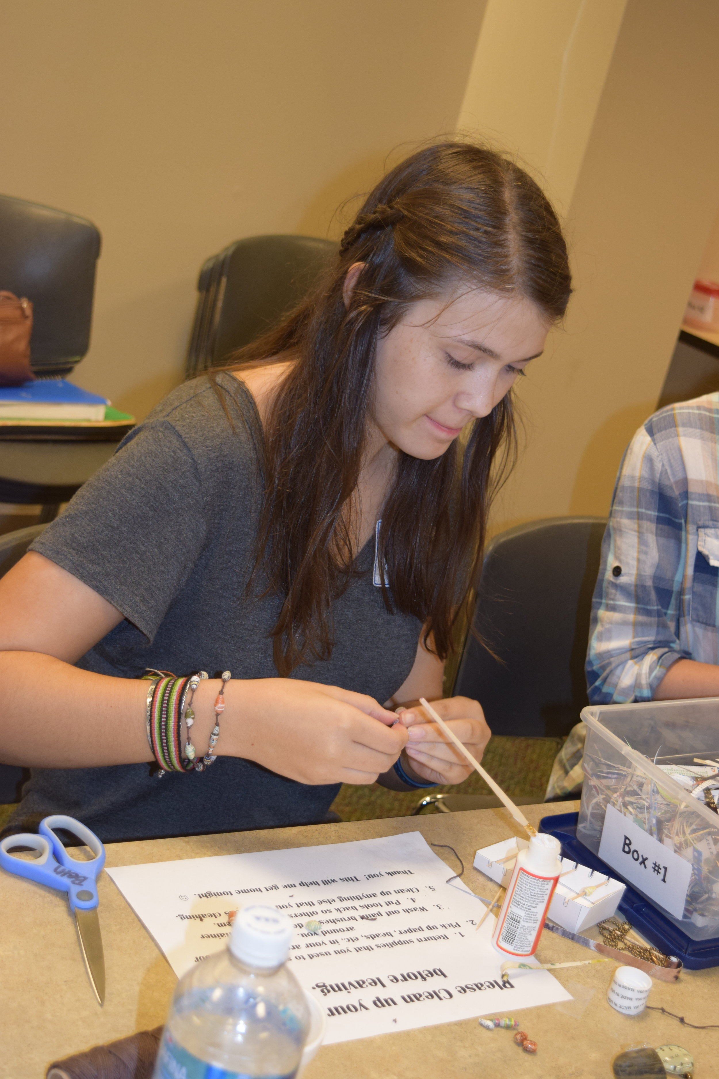 Mary Kate Conley works on her project with precision.