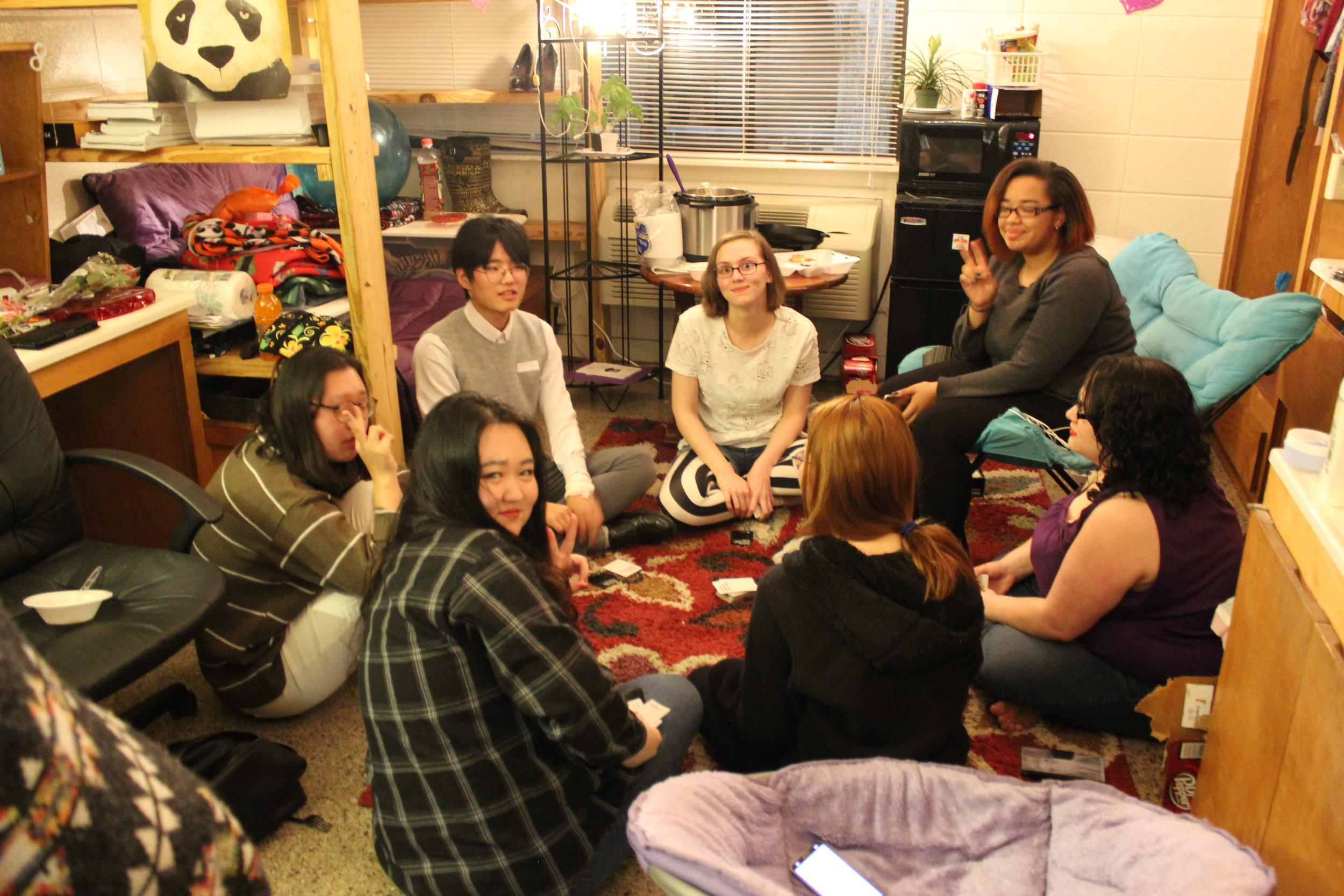 Nisa Navarro, an interdisciplinary English and communication major, Hannah Bate, a linguistics and English major, Ashia Davenport, a criminal justice and linguistics major and their guests Lily, Shawn, and Nancy enjoy the open dorms with a card game.