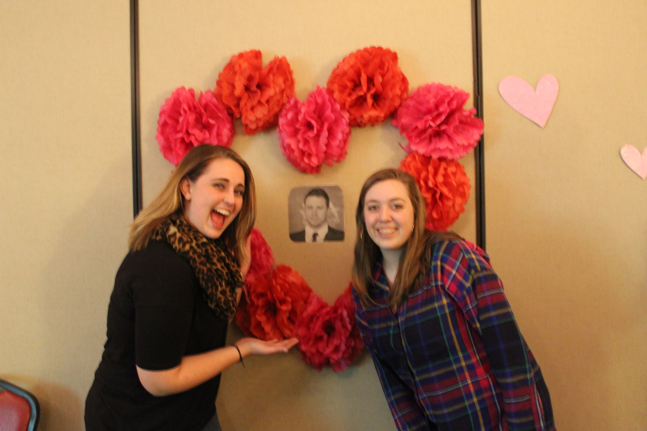 Kady Floyd, business administration major, and Morgan Bryant ,a CWAL major,admire the masterpiece.
