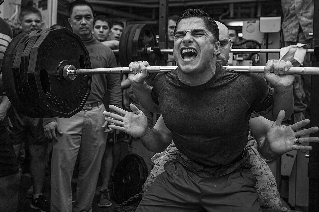 Jace Manning, Marine Medium Tiltrotor Squadron (VMM) 263 (Reinforced), 22nd Marine Expeditionary Unit (MEU), air traffic control staff noncommissioned officer in charge and native of Belton, Texas, squats 385 pounds during a weight-lifting competition aboard the USS Bataan (LHD 5), at sea, April 20, 2014. Photo courtesy of Wikimedia Commons.