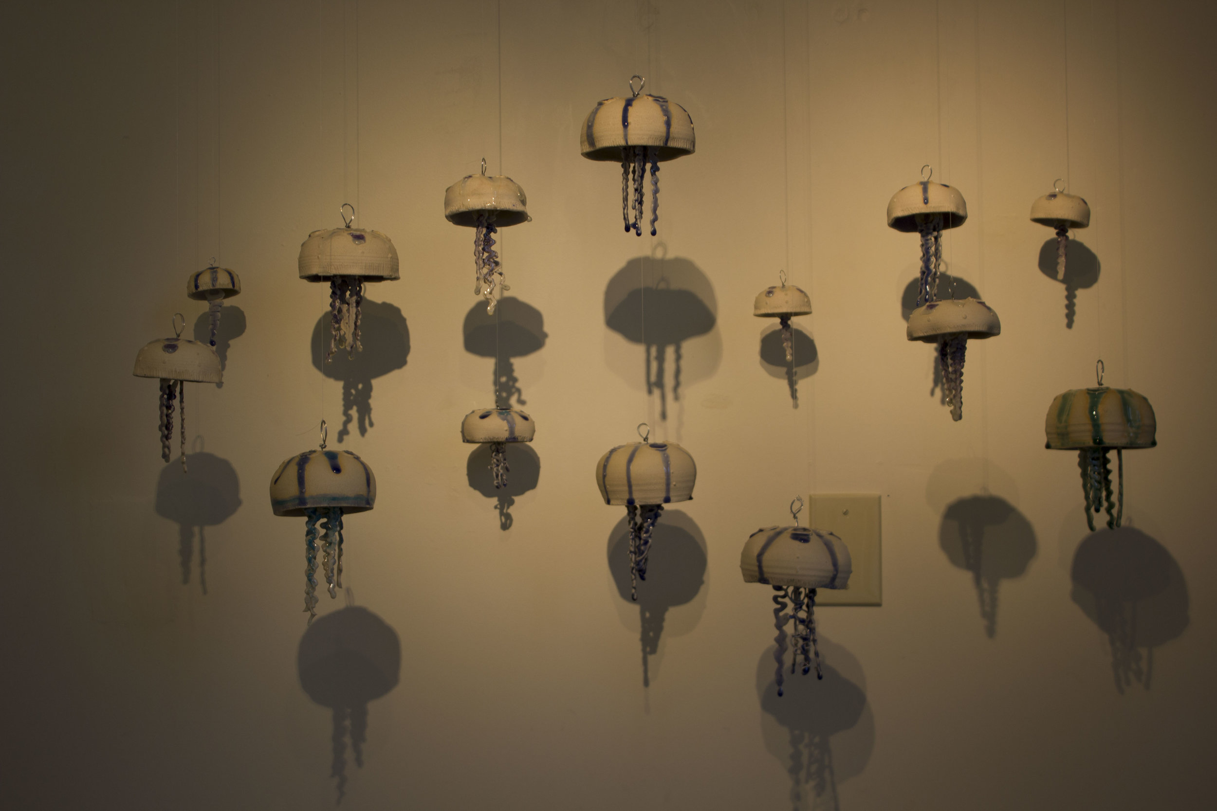 Hayley Douglas' bloom of hanging ceramic jellyfish. Douglas is an instructor of graphic arts and ceramics at NGU.