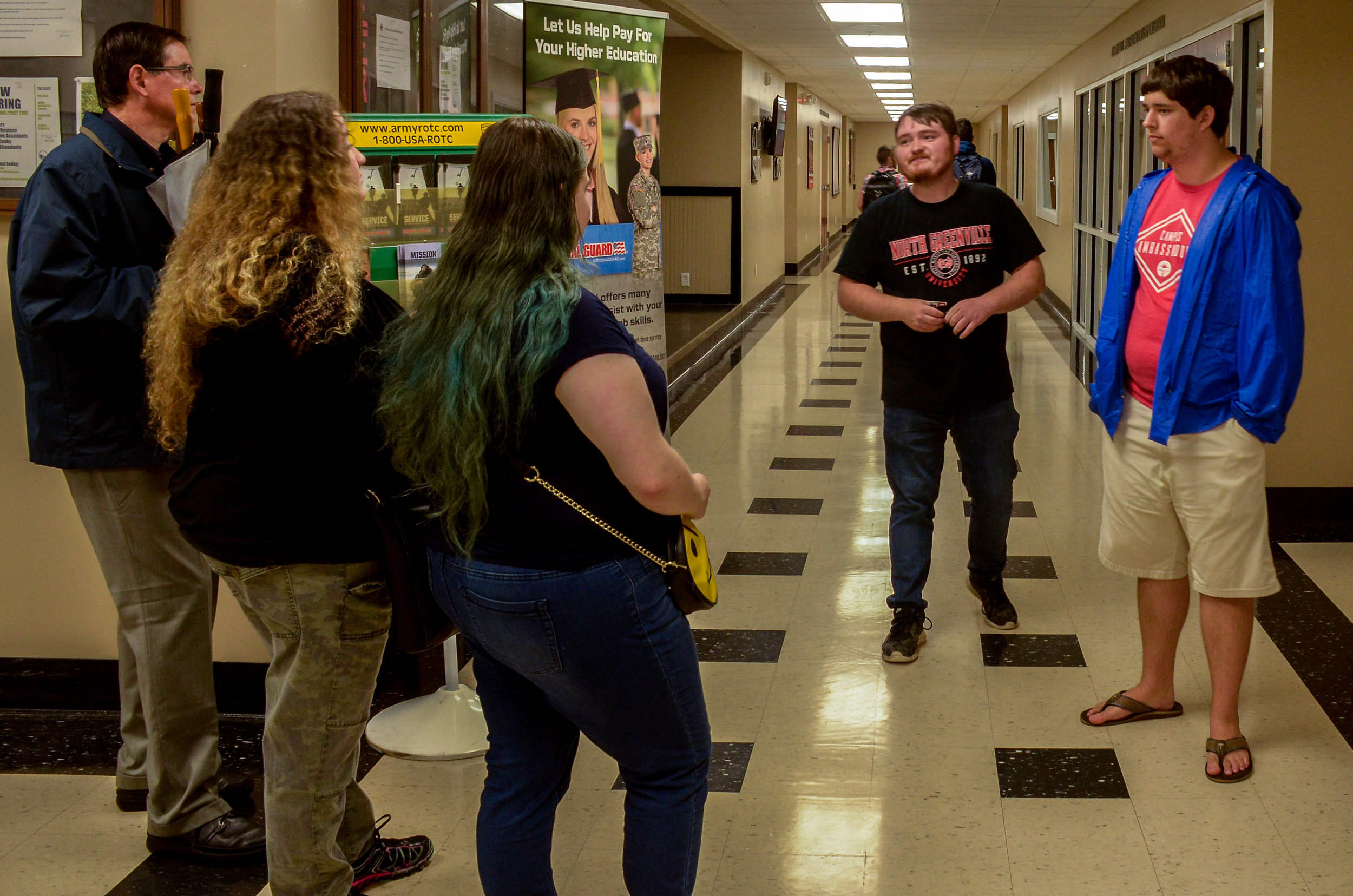 NGU students provide tours to potential Crusaders showing where students hang out, buy books and play games.