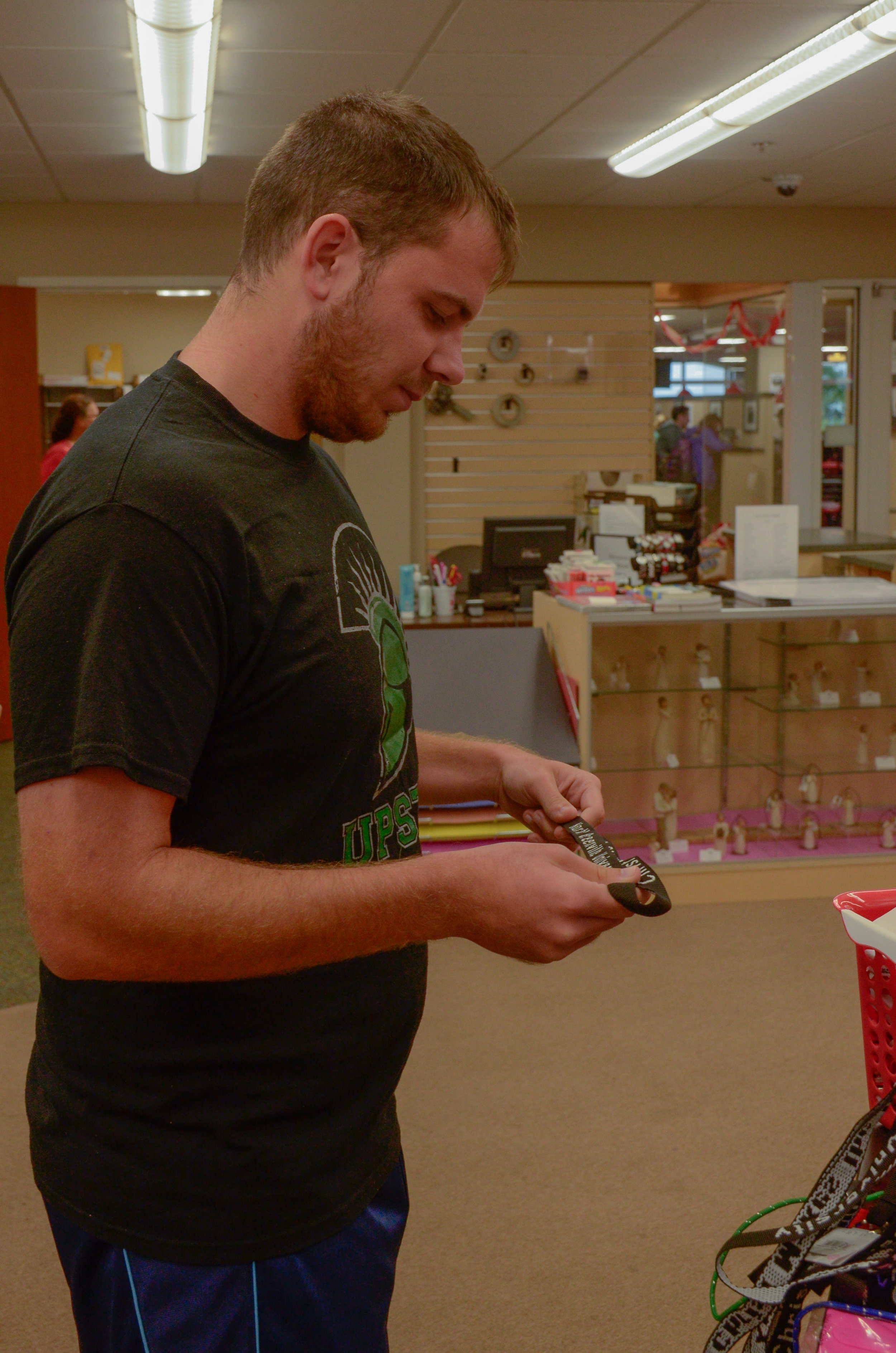 Jade Bridges, senior, spends his free time at the campus bookstore shopping for souvenirs for his last year at NGU.