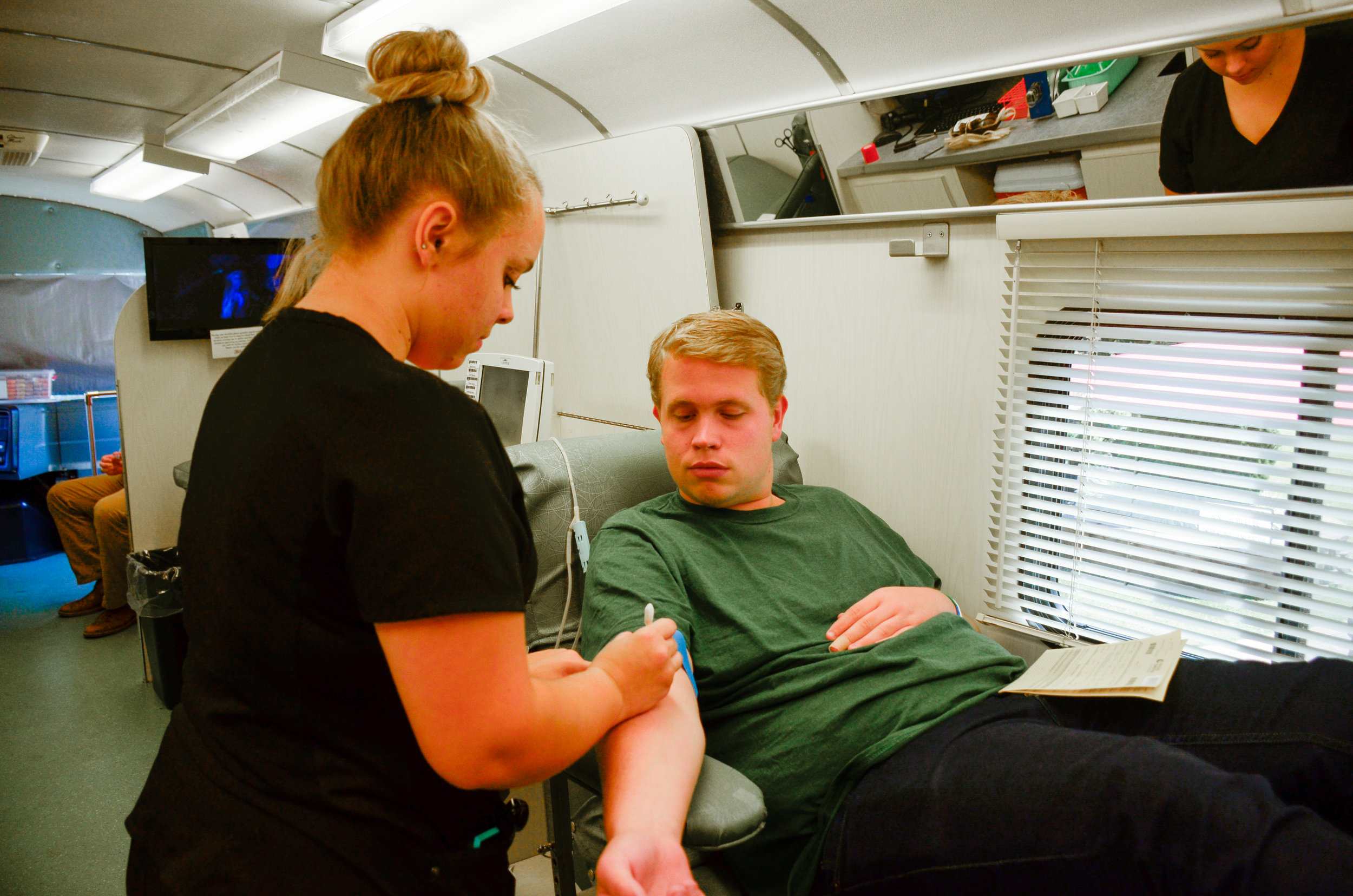 """Austin Cathey, sophomore, prepares himself to donate blood because, """"it's the right thing to do to help those who need blood."""""""