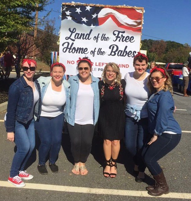 Macy McDonald, vice president of the Big Little program, and others pose at the Homecoming Parade last year.