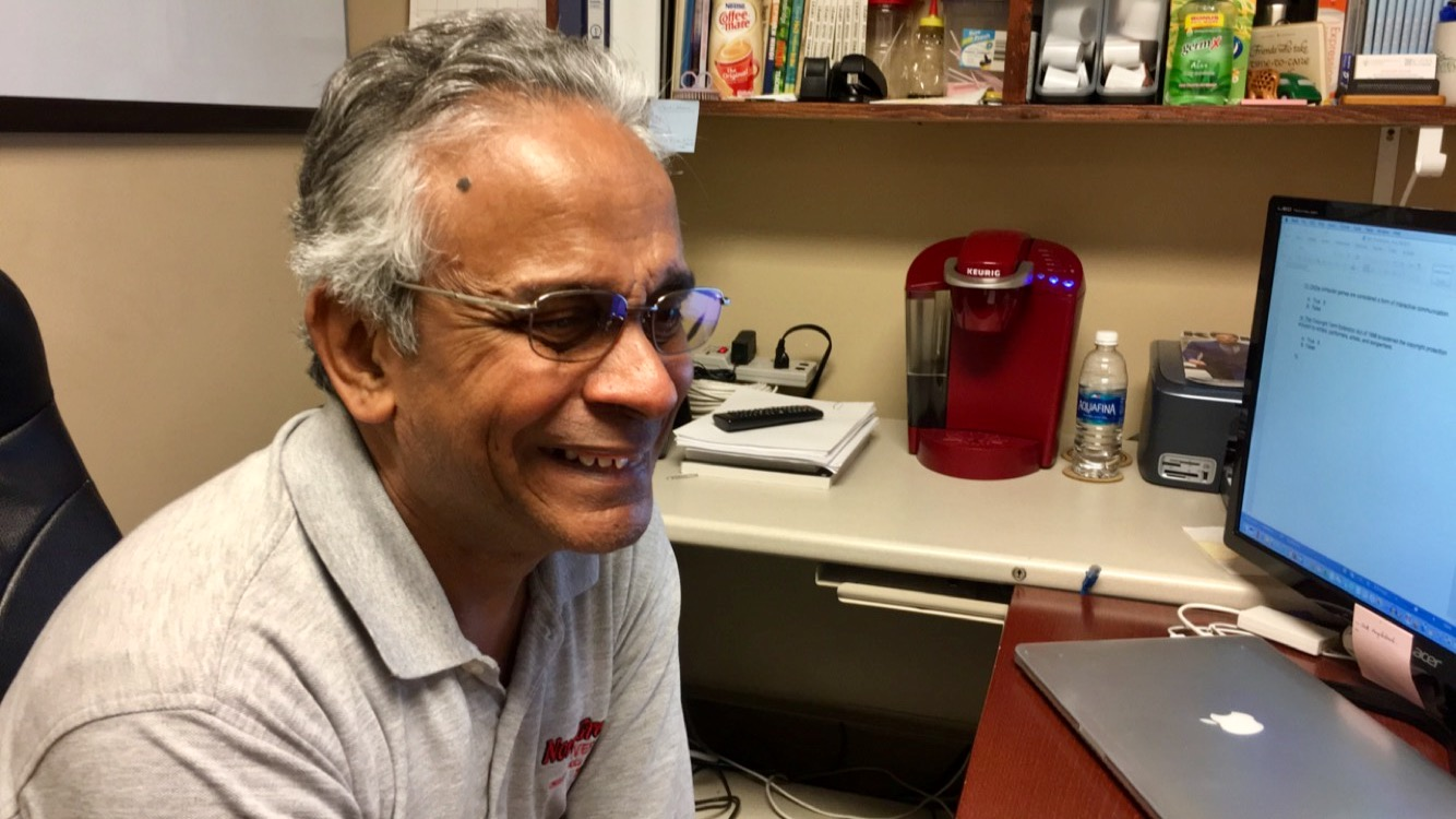 Professor Shur Gopal advises a mass communication student over a cup of coffee.
