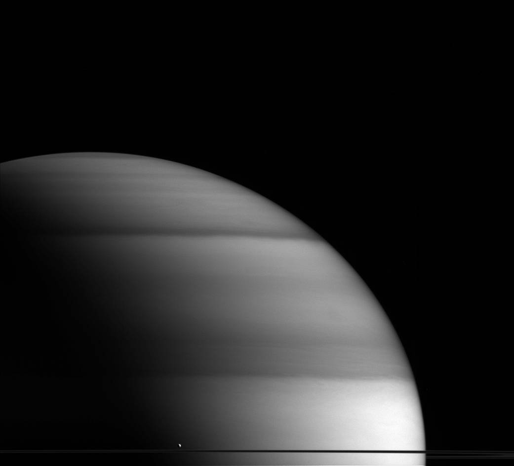"""2.  """"The Dew Drop of Saturn""""   A tiny white spec compared to Saturn, Enceladus is the planet's 6th largest moon."""