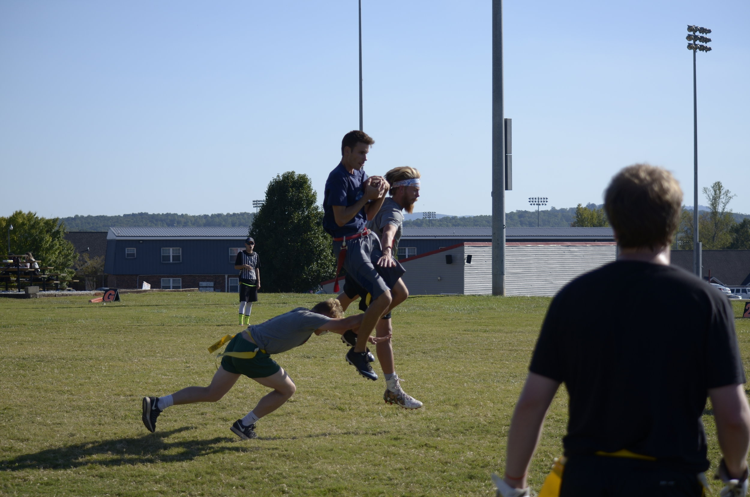 Andrew Chisholm gets up to catch a pass from his teammates around his strong defenders.