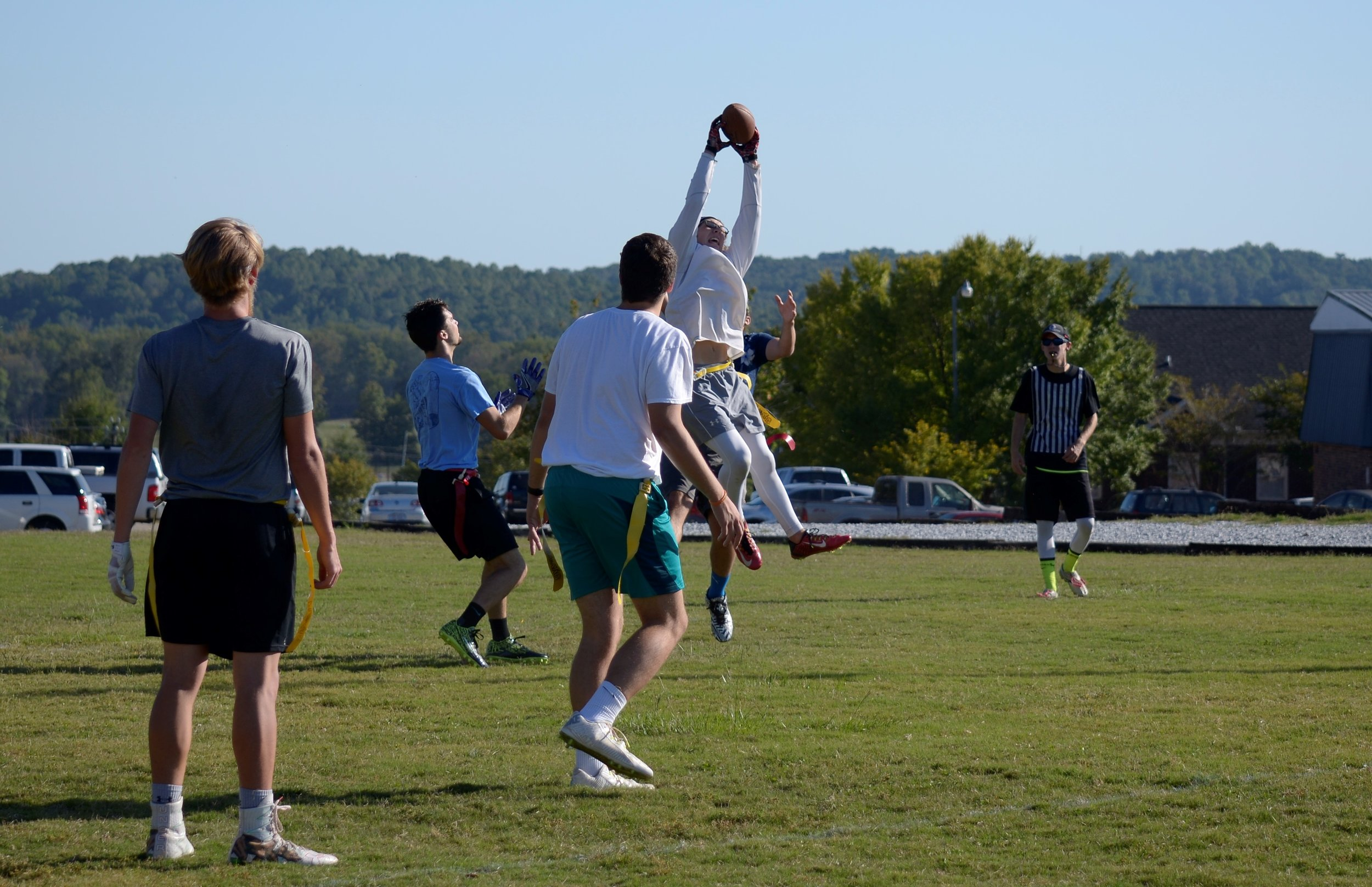 Jonathan Varner catches a great throw past his defenders for a touchdown.