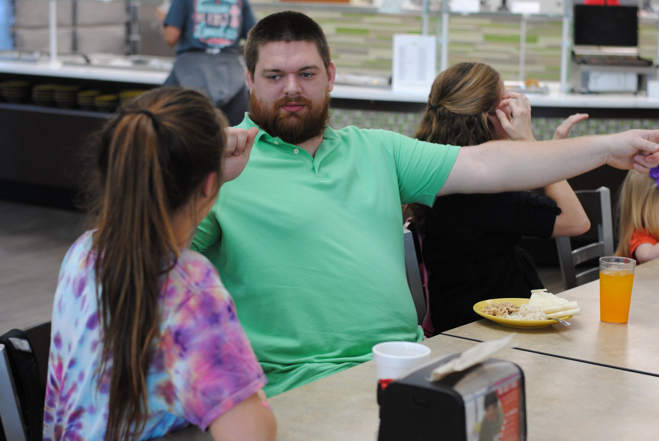 Mike Sizemore and Paige Meyer (sophomore)engage in conversation.