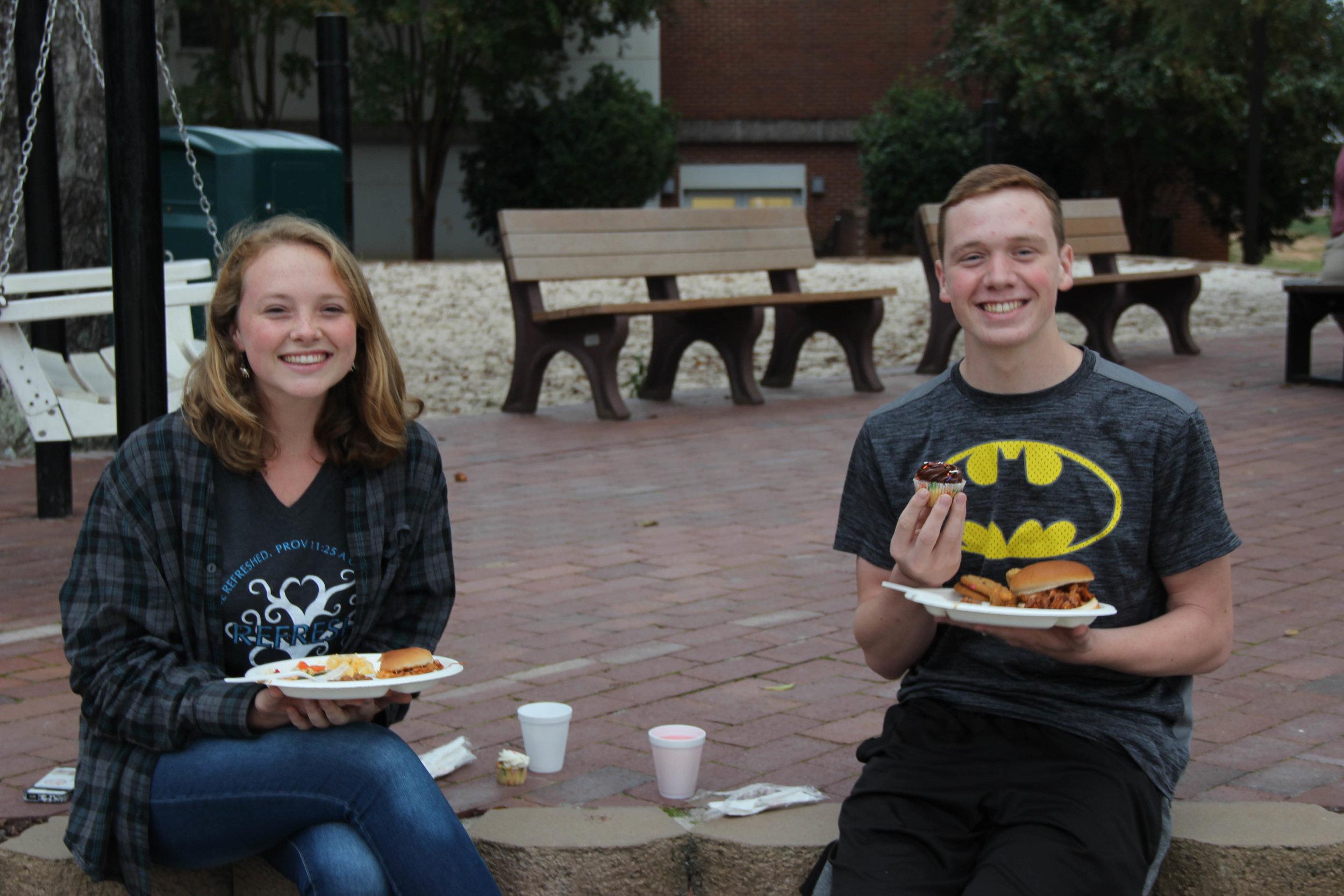 Jessica Pearce (Senior)and Andrew Pearce (Freshman)eating cupcakes.