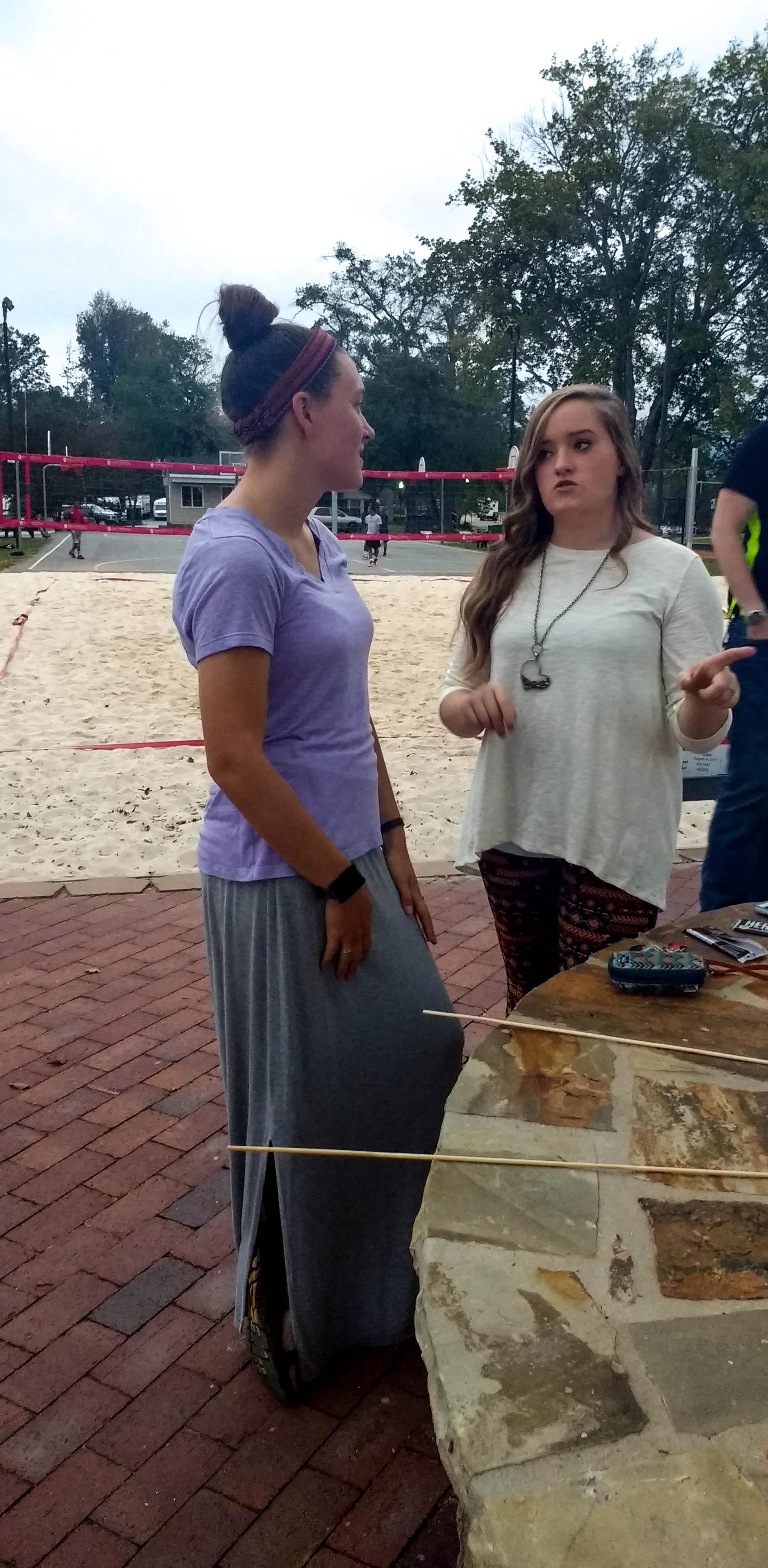 Rebecca Komoroski (Senior)and Christine Adcock (Senior)talking over s'mores.