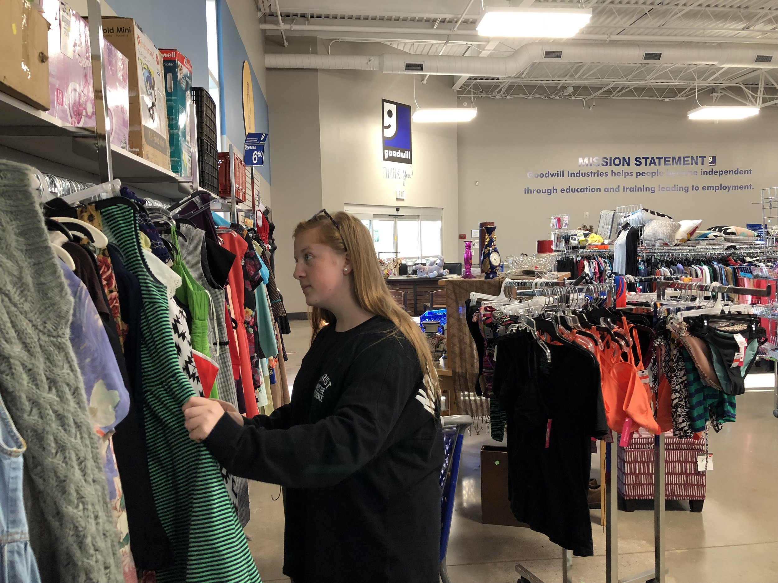 Mary Mahan (Sophmore, Broadcast Media) looks through the dress rack at Goodwill.  Source: Adam Kelly