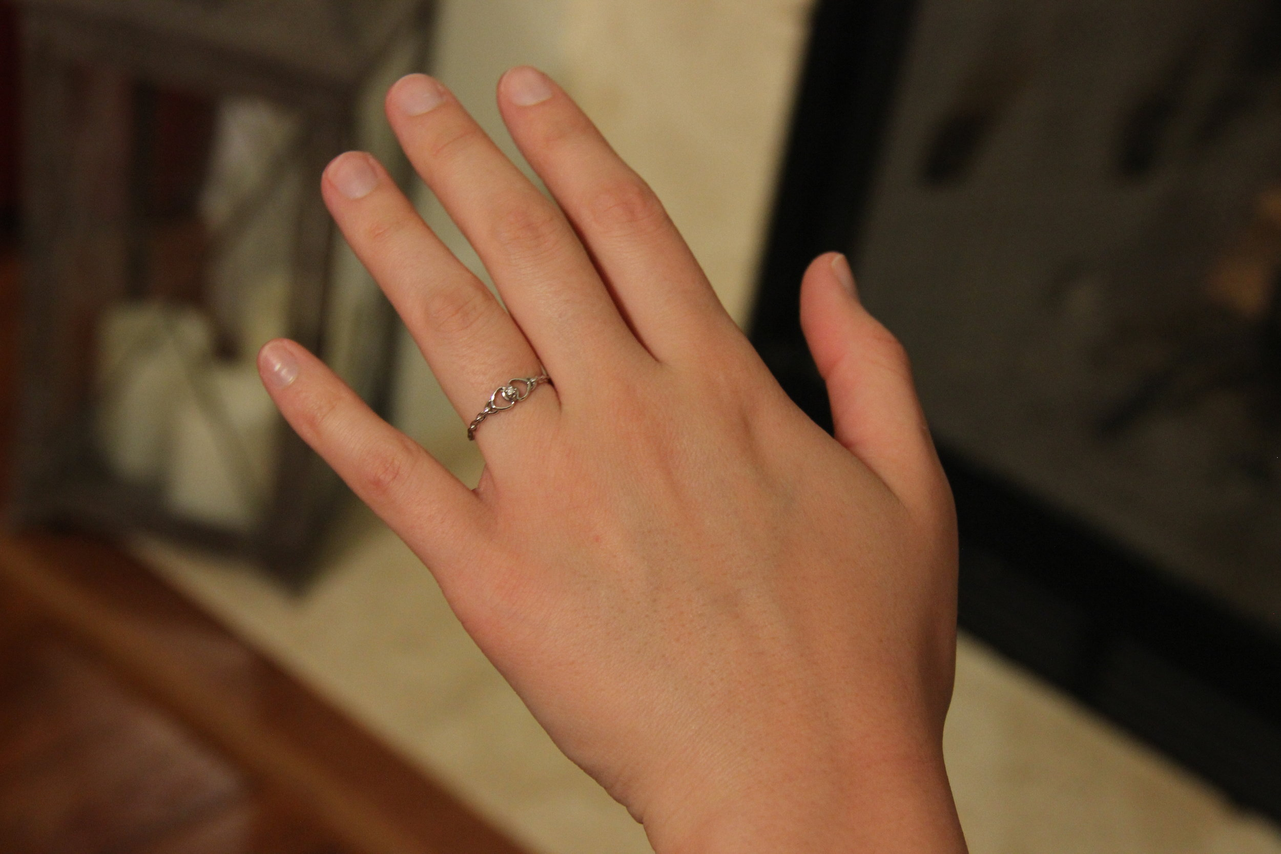 Rachel Daniel (Freshman - Broadcast Media)posing with a ring her dad bought her for a graduation gift.