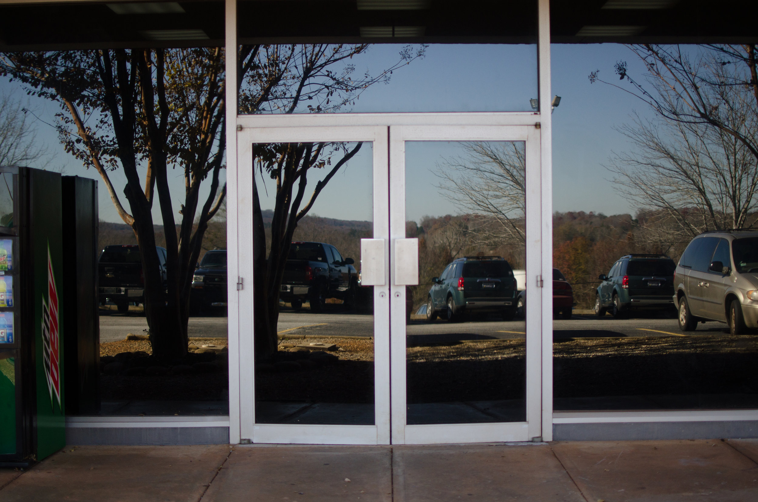 The Brisse Suite contains the language lab and a few classrooms. The entrance to this is outside behind the library. Follow the pathway through the parking lot and behind the library you will see two double doors.