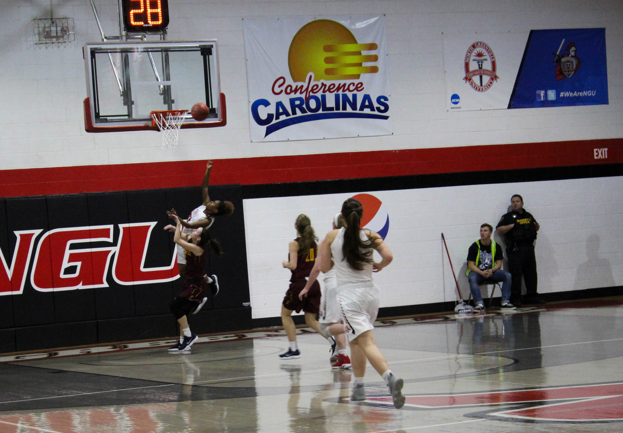 After getting a fast break down the court, Savannah Hughes (21) goes up and makes a layup.