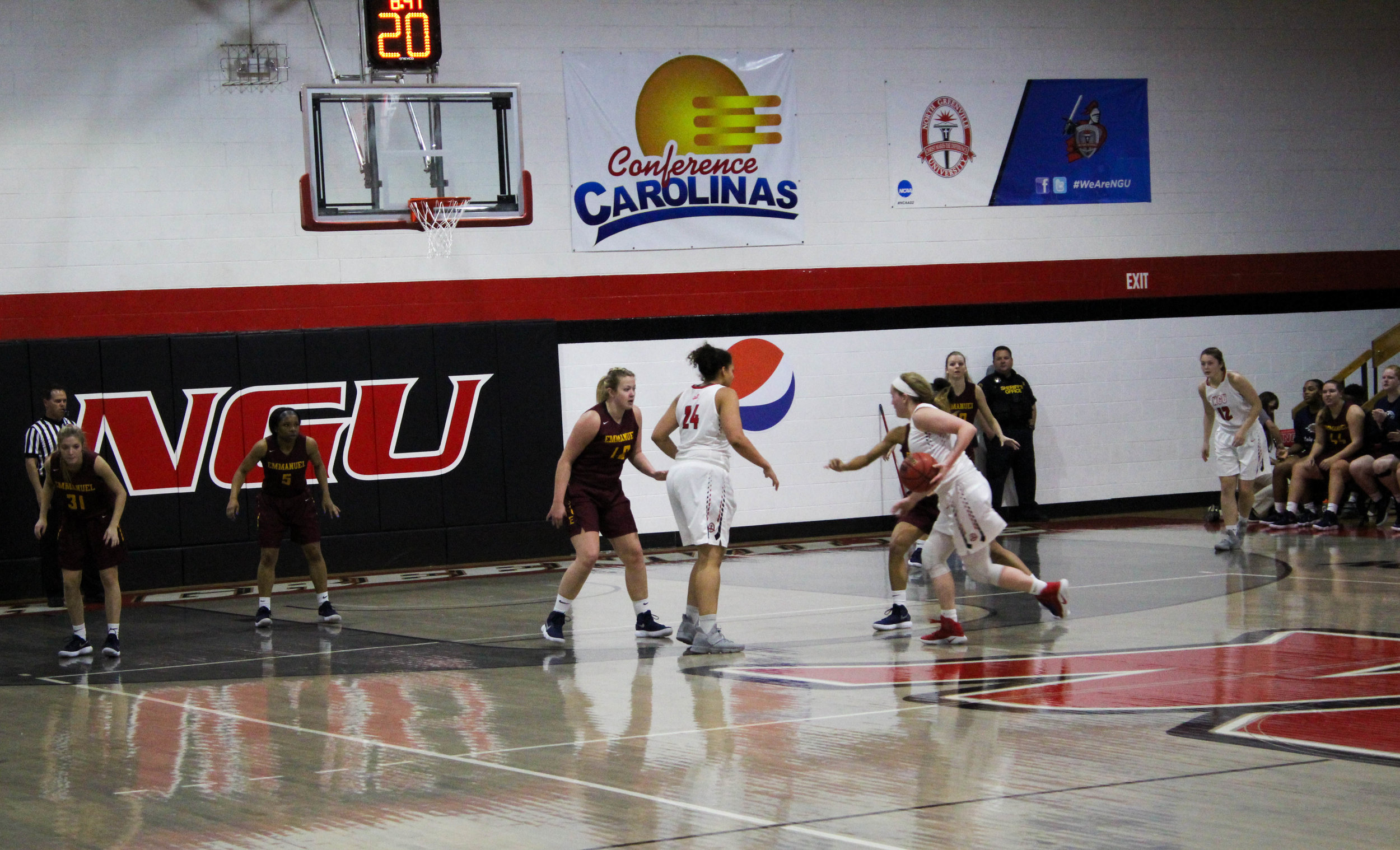 Karen Donehew (14) drives down the lane towards the basket.