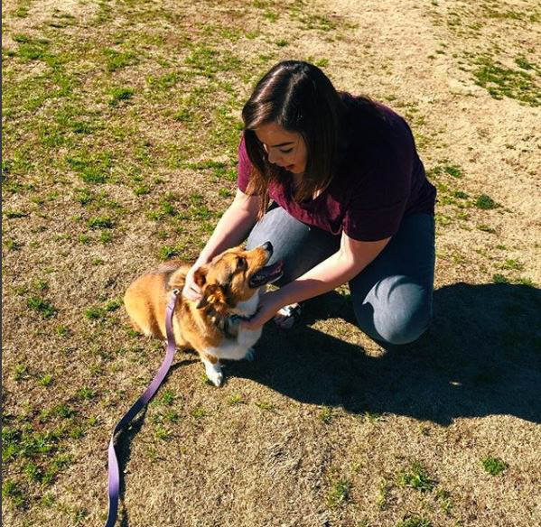 Taylor Deaton, a freshman digital media major, relieves her stress during a busy week by playing with a special visitor to the school.