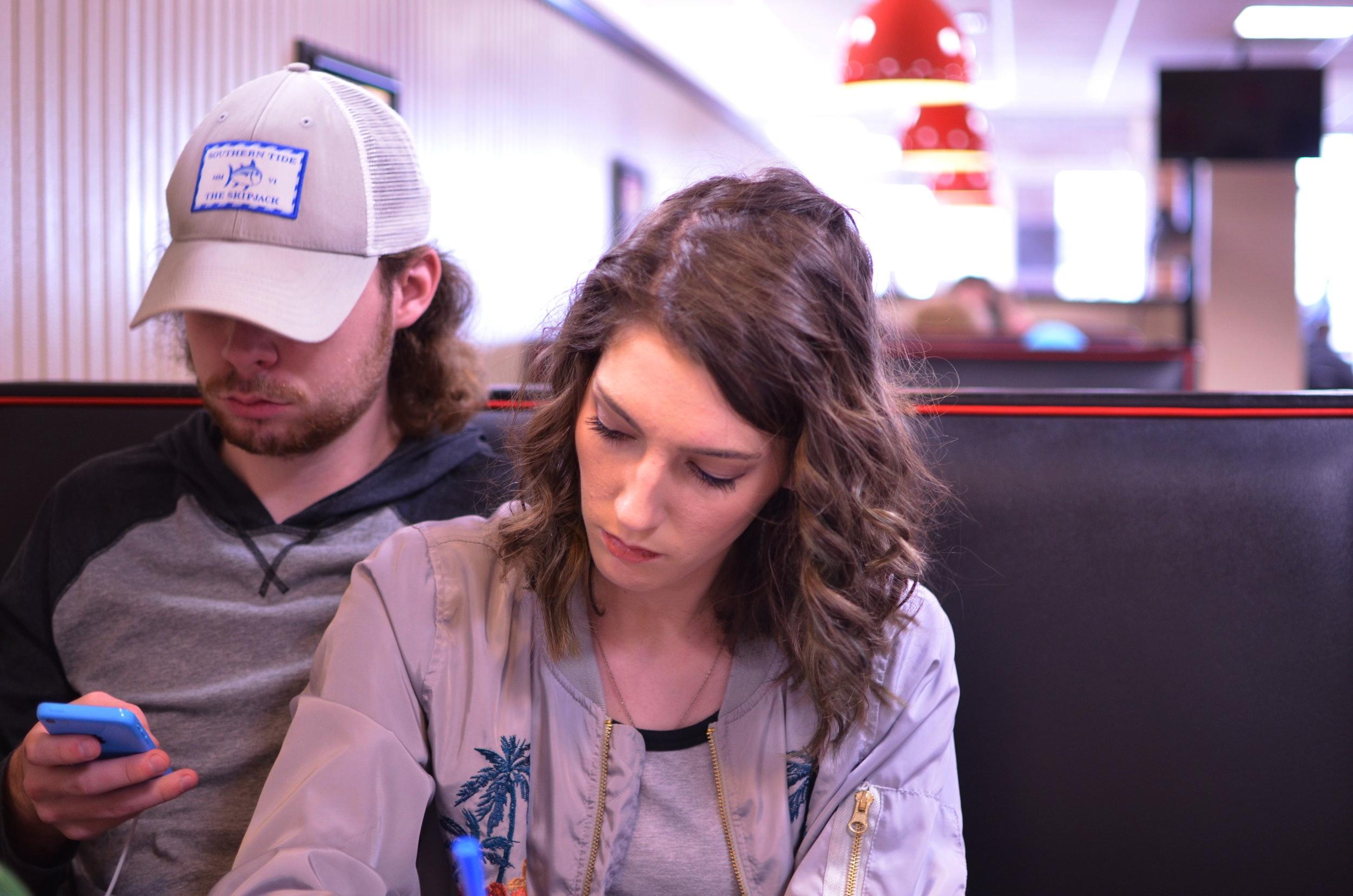 Madison Giles and Benjamin London work on school work.